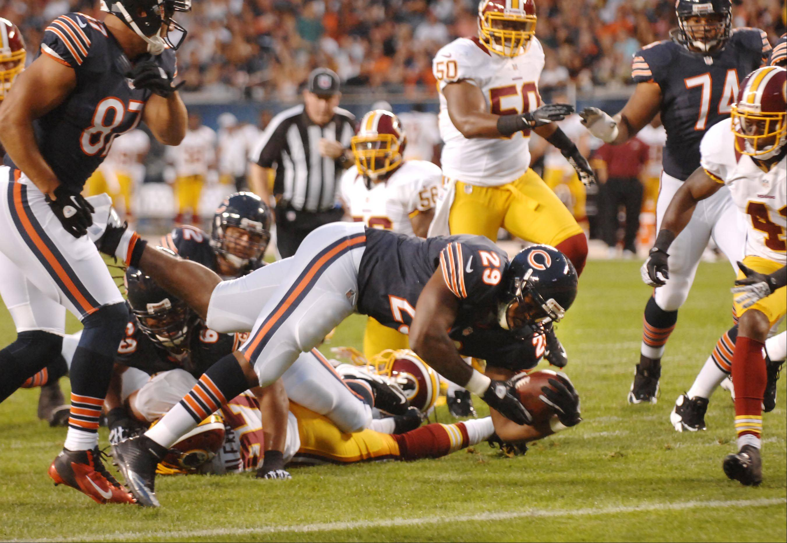 Chicago Bears running back Michael Bush scores his second first-half touchdown Saturday against the Washington Redskins in the second preseason game at Soldier Field in Chicago.
