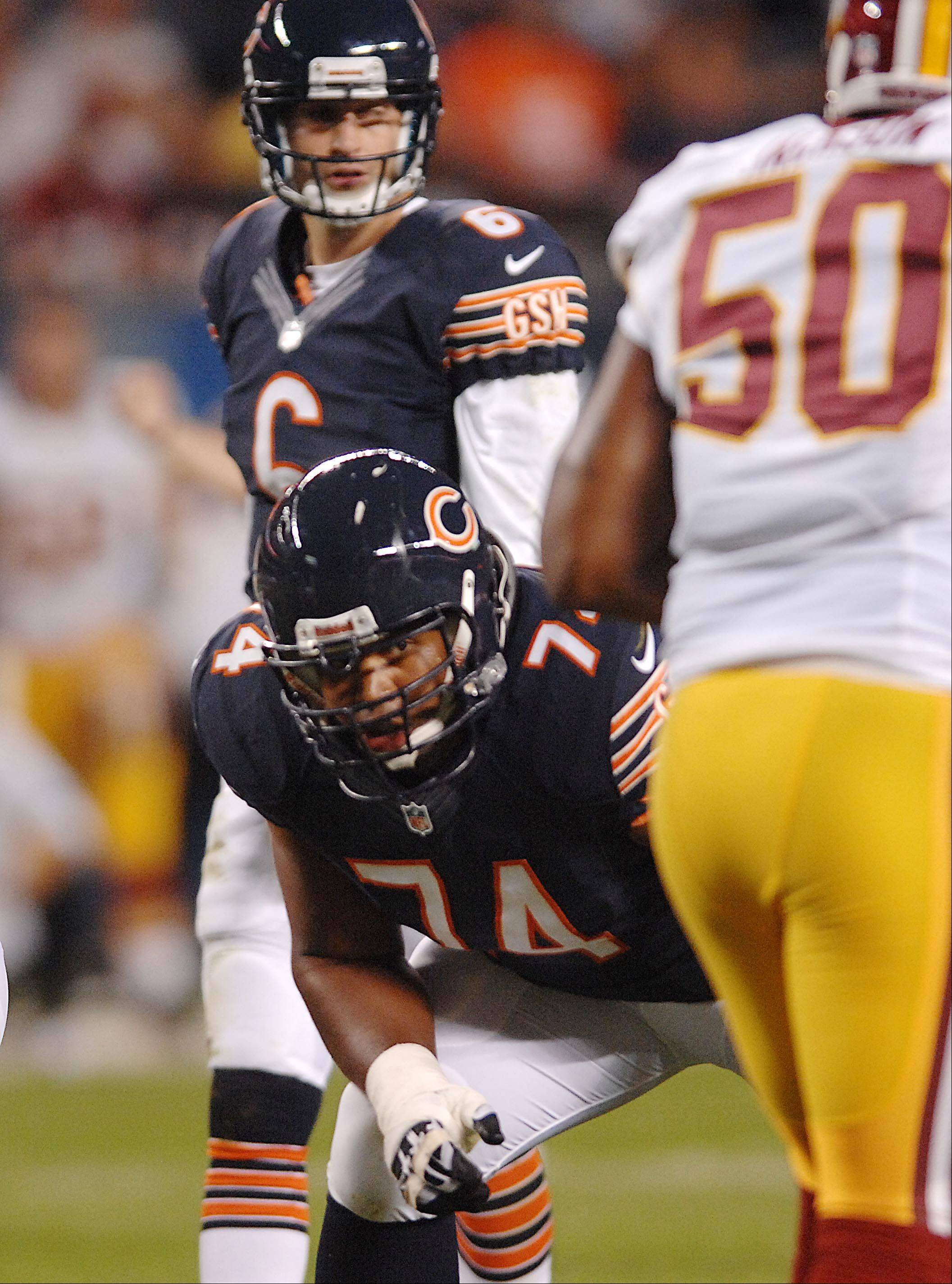 Chicago Bears offensive tackle Chris Williams lines up with Jay cutler behind him Saturday against the Washington Redskins in the second preseason game at Soldier Field in Chicago.