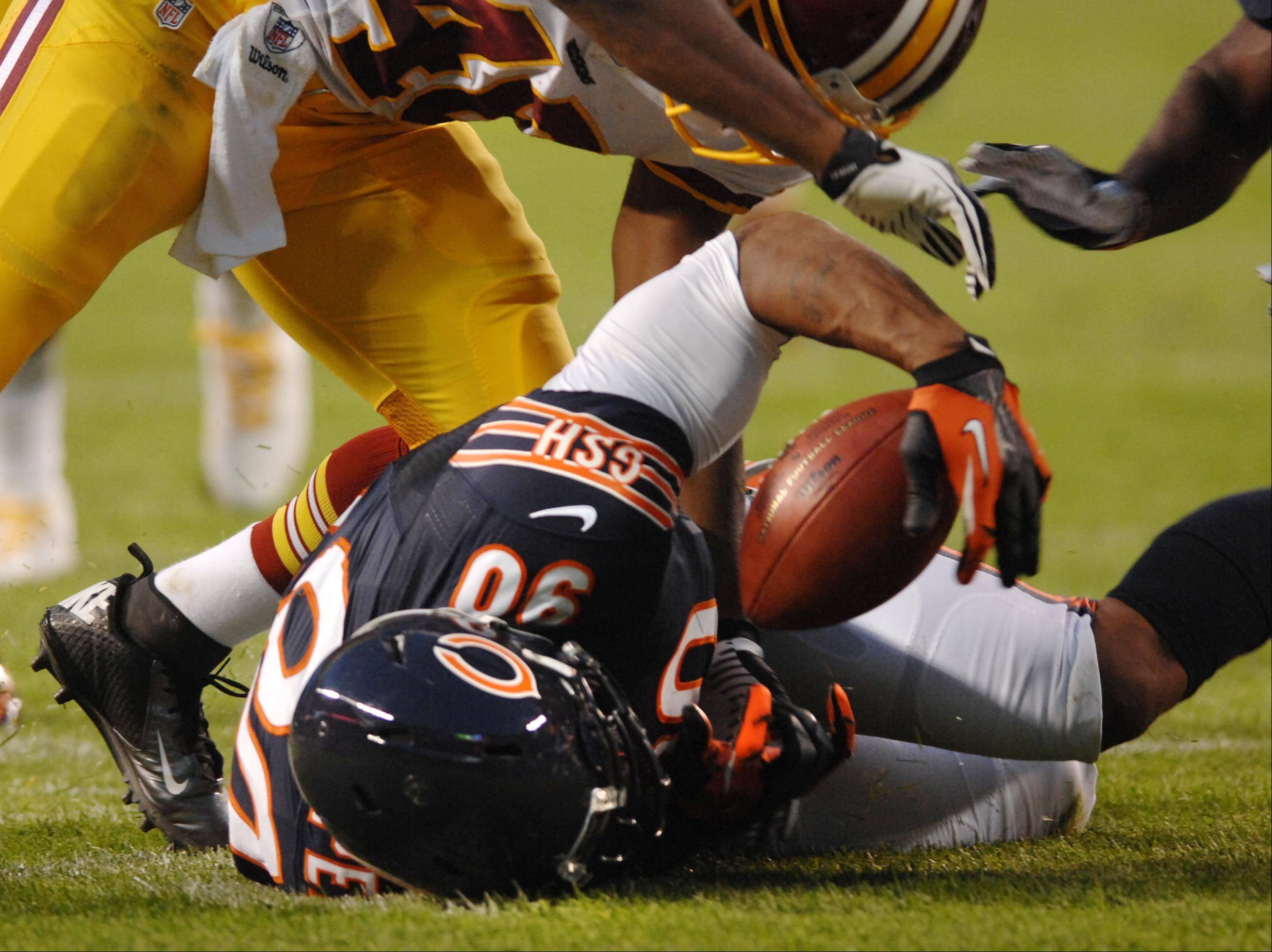 Chicago Bears defensive end Julius Peppers recovers a fumble in the first half Saturday against the Washington Redskins in the second preseason game at Soldier Field in Chicago.
