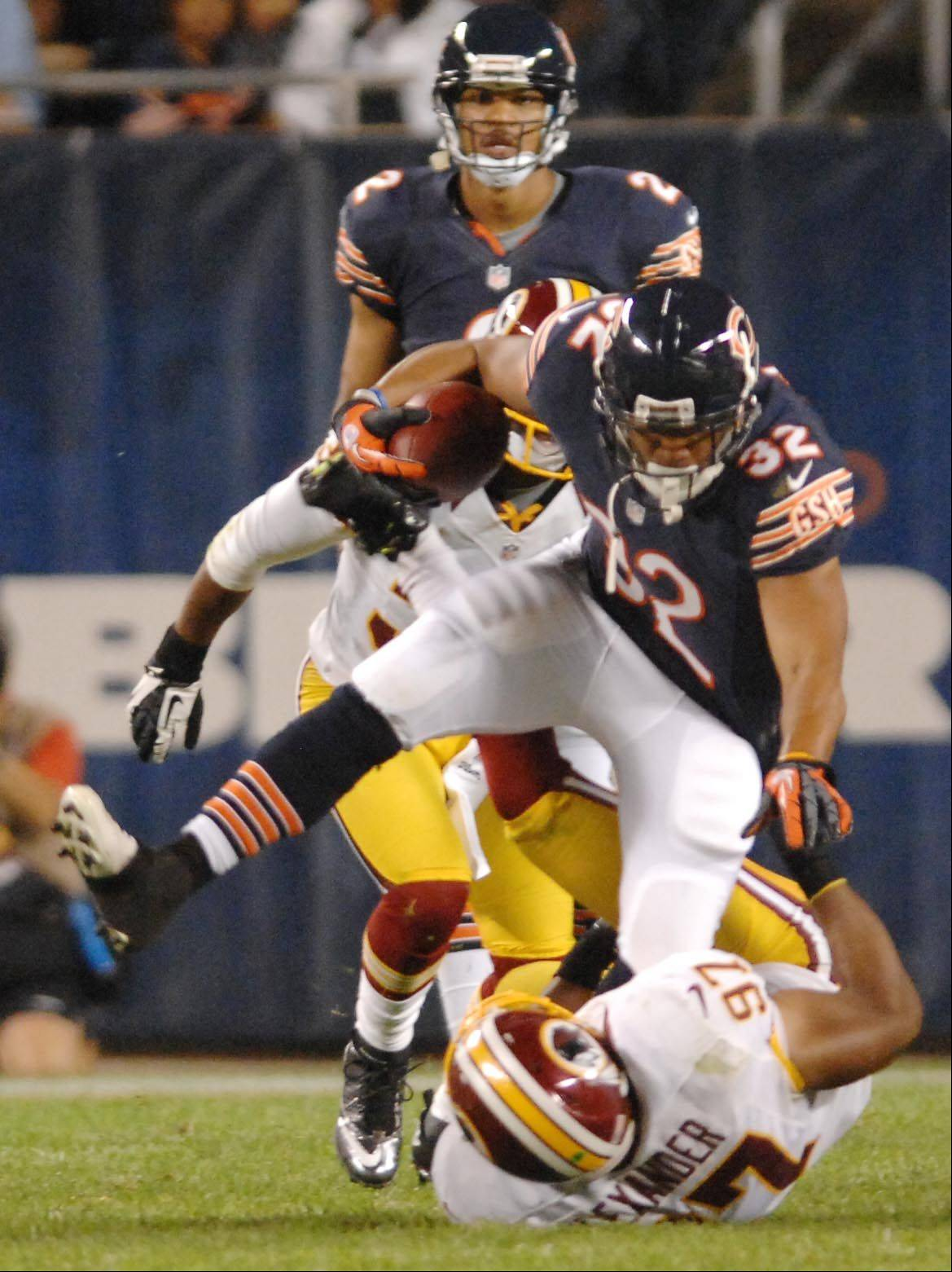Chicago Bears running back Kahlil Bell is pulled down by Washington Redskins linebacker Lorenzo Alexander Saturday in the second preseason game at Soldier Field in Chicago.