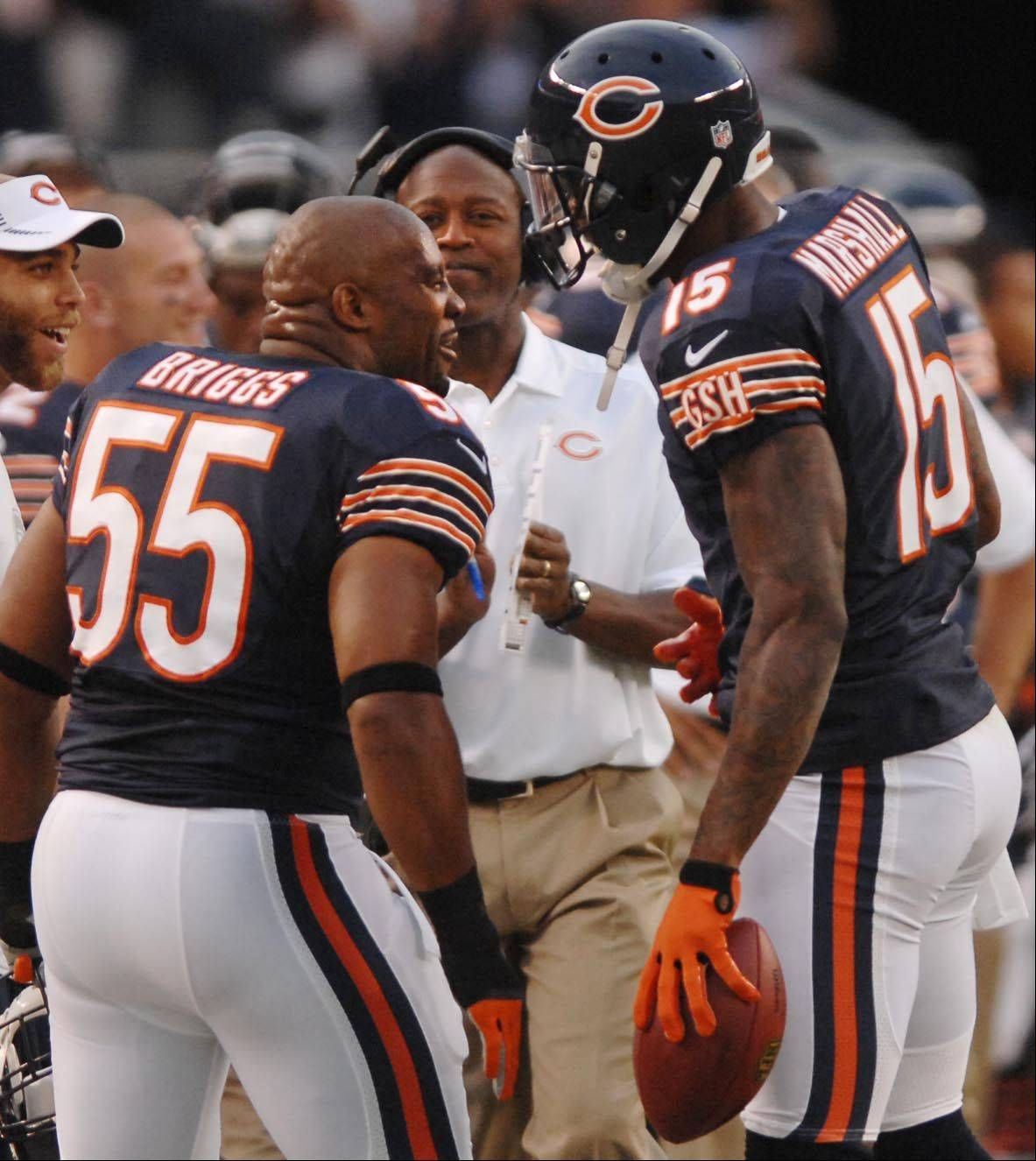 Chicago Bears wide receiver Brandon Marshall comes to the sidelines and linebacker Lance Briggs as coach Lovie Smith applauded his first-down catch Saturday against the Washington Redskins in the second preseason game at Soldier Field in Chicago.