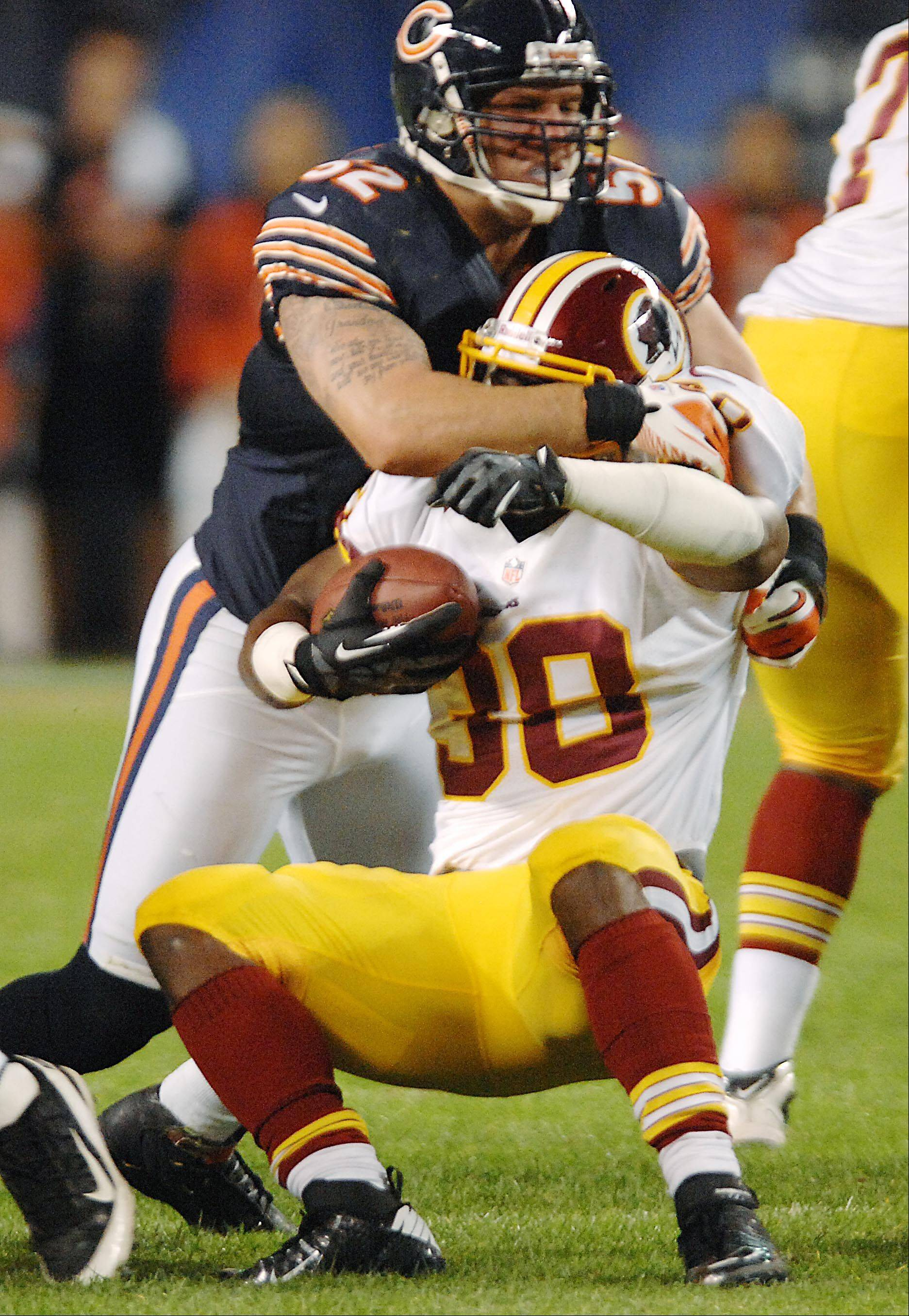 Chicago Bears linebacker Blake Costanzo stops Washington Redskins running back Tristan Davis Saturday in the second preseason game at Soldier Field in Chicago.
