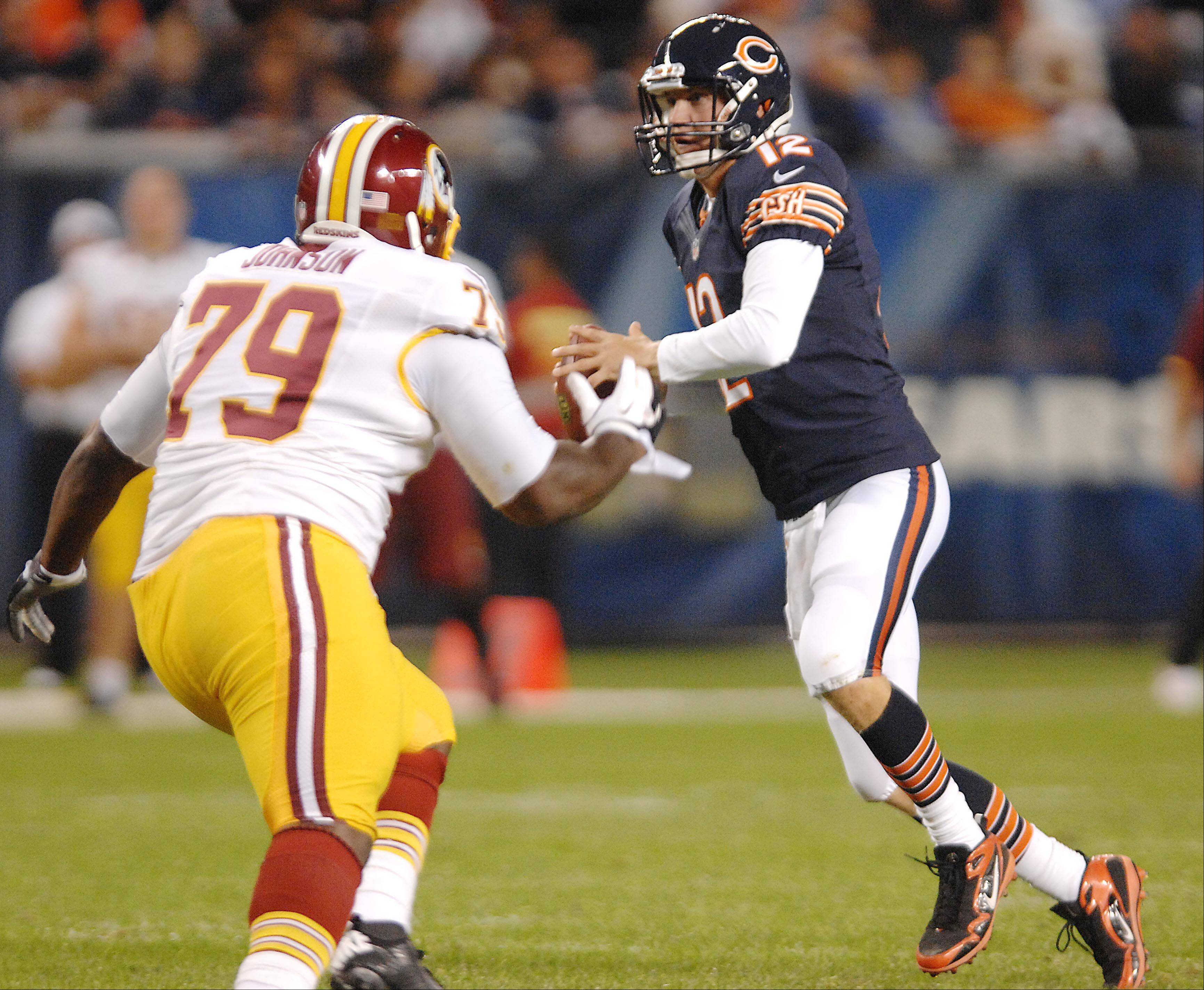 Chicago Bears quarterback Josh McCown looks for a receivers as Washington Redskins offensive guard Maurice Hurt charges Saturday in the second preseason game at Soldier Field in Chicago.