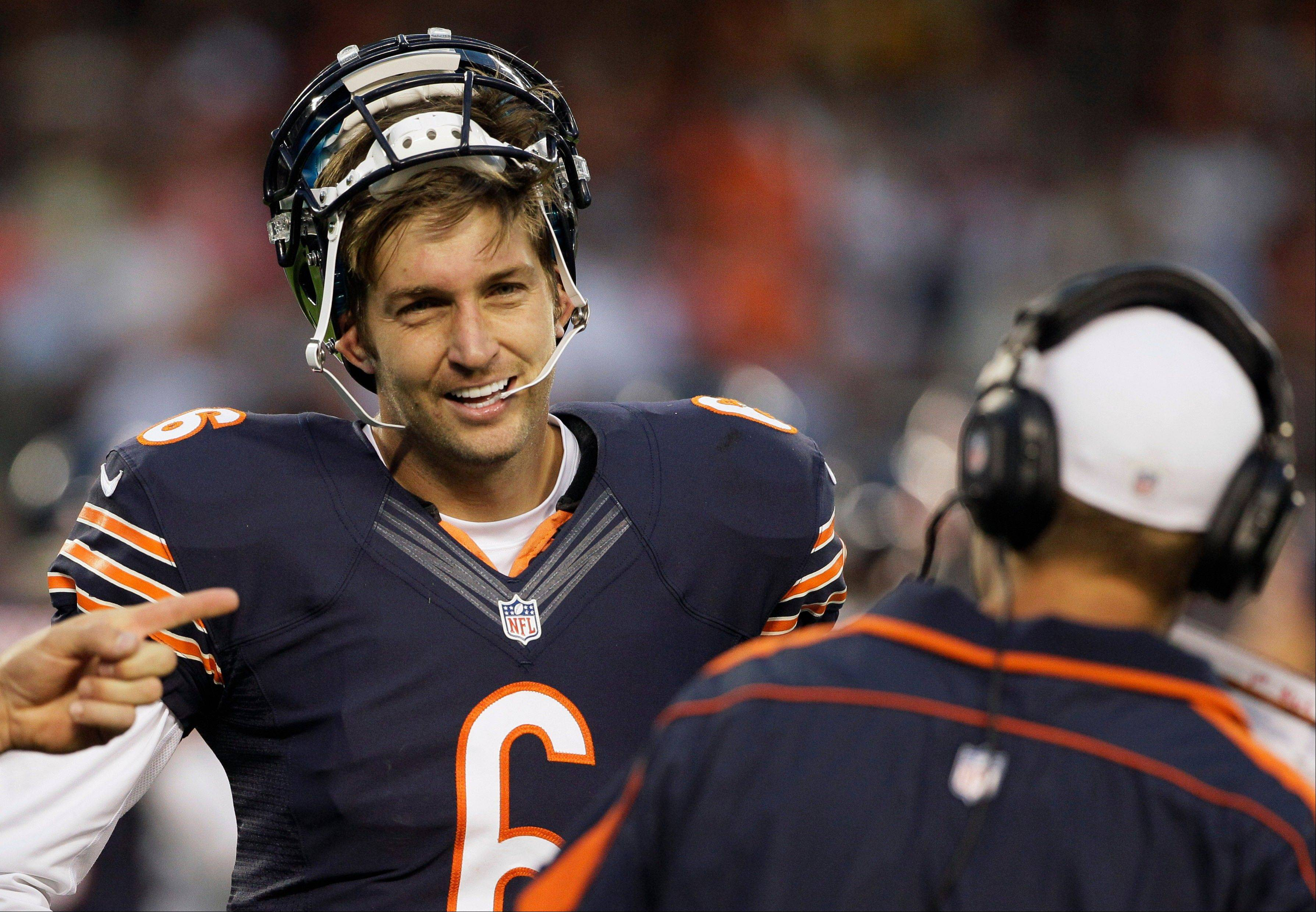 Chicago Bears quarterback Jay Cutler smiles as he talks with quarterbacks coach Jeremy Bates during the first half of an NFL preseason football game against the Washington Redskins in Chicago, Saturday, Aug. 18, 2012.