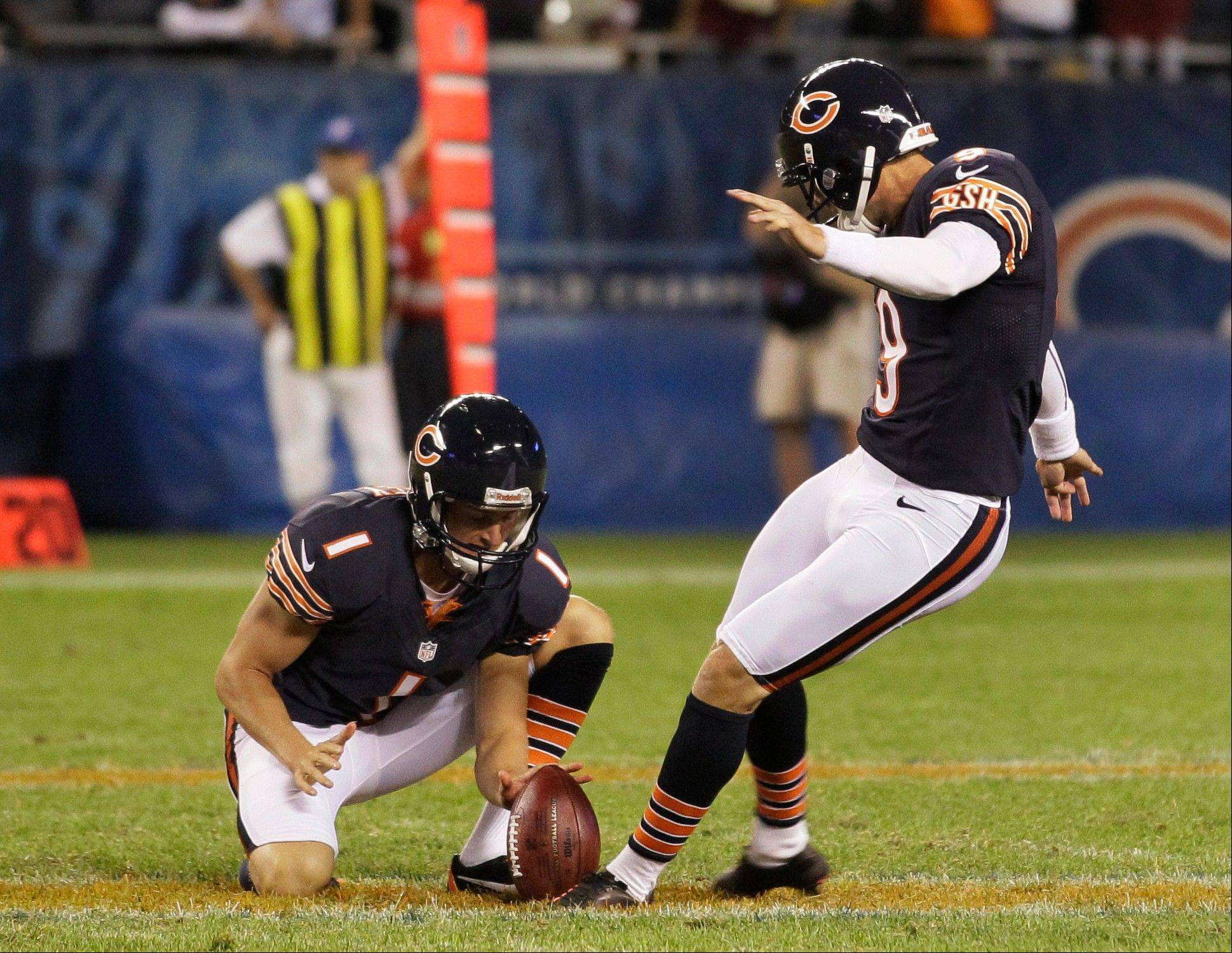 Chicago Bears' Robbie Gould (9) kicks a field goal to give the Bears a 33-31 win over the Washington Redskins in an NFL preseason football game in Chicago, Saturday, Aug. 18, 2012. Holding is Ryan Quigley.
