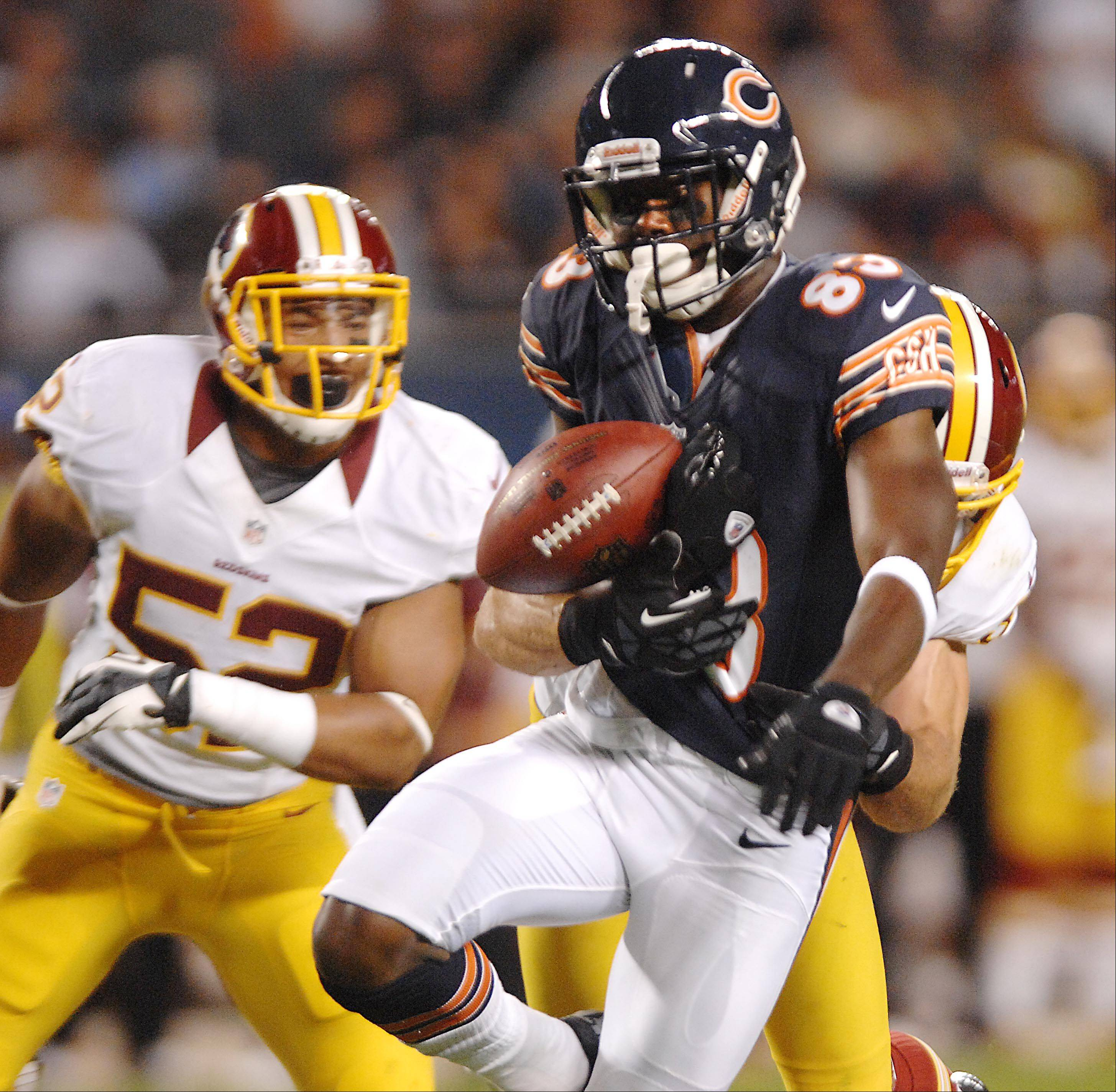 Chicago Bears wide receiver Chris Summers fumbles the ball after making a catch Saturday against the Washington Redskins in the second preseason game at Soldier Field in Chicago. The turnover led to a tying touchdown late in the game for the Redskins.