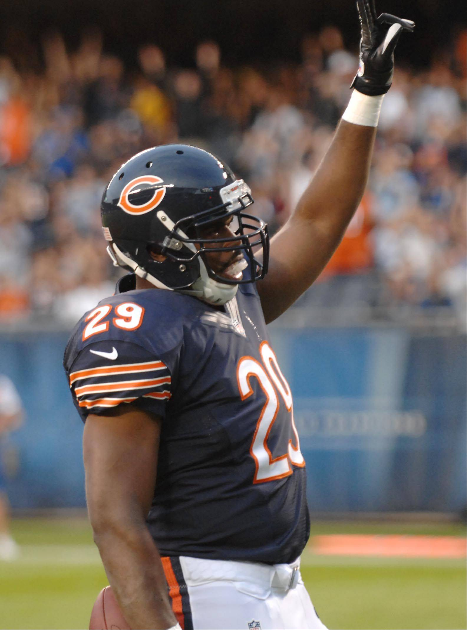 Chicago Bears running back Michael Bush signals to the crowd after his first touchdown Saturday against the Washington Redskins in the second preseason game at Soldier Field in Chicago.