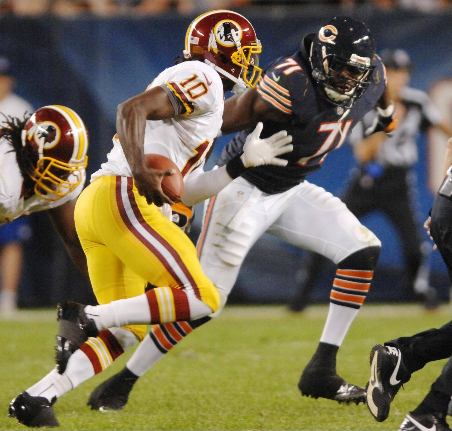 Chicago Bears defensive end Israel Idonije runs down Washington Redskins quarterback Robert Griffin III Saturday in the second preseason game at Soldier Field in Chicago.