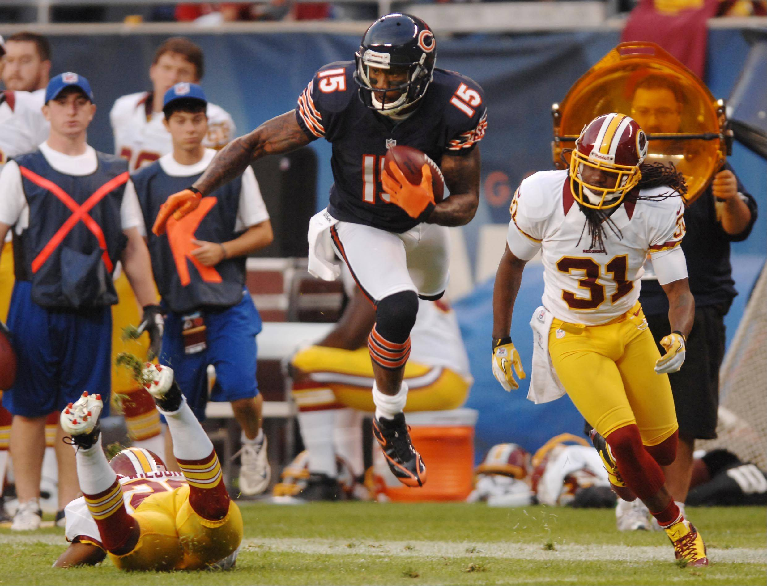 Chicago Bears wide receiver Brandon Marshall jumps over Washington Redskins defensive back Josh Wilson as defensive back Brandon Meriweather covers Saturday in the second preseason game at Soldier Field in Chicago.
