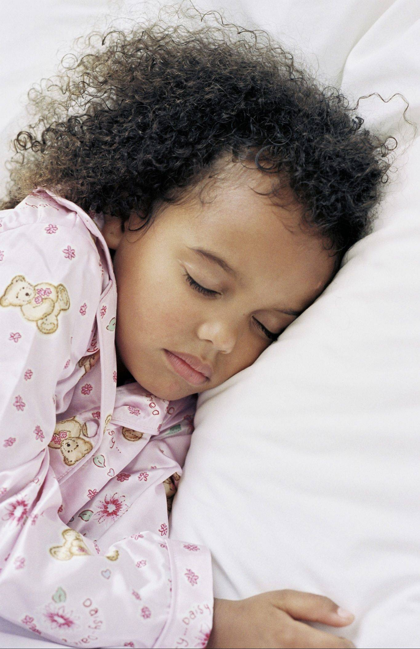 Experts recommend gradually getting children into a regular sleep routine before school begins.