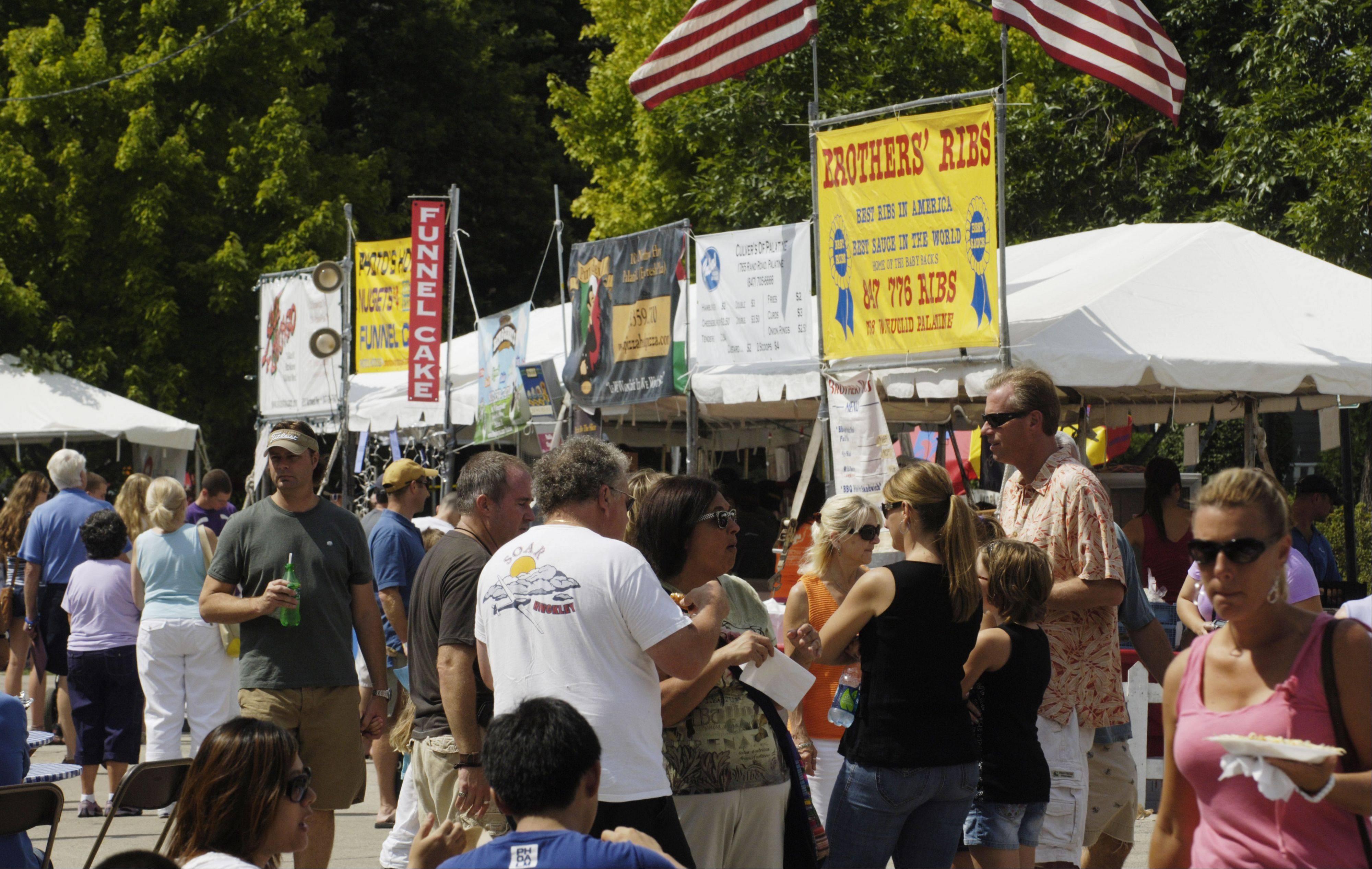 Patrons gather near the food booths during the 2011 Palatine Downtown Street Fest.
