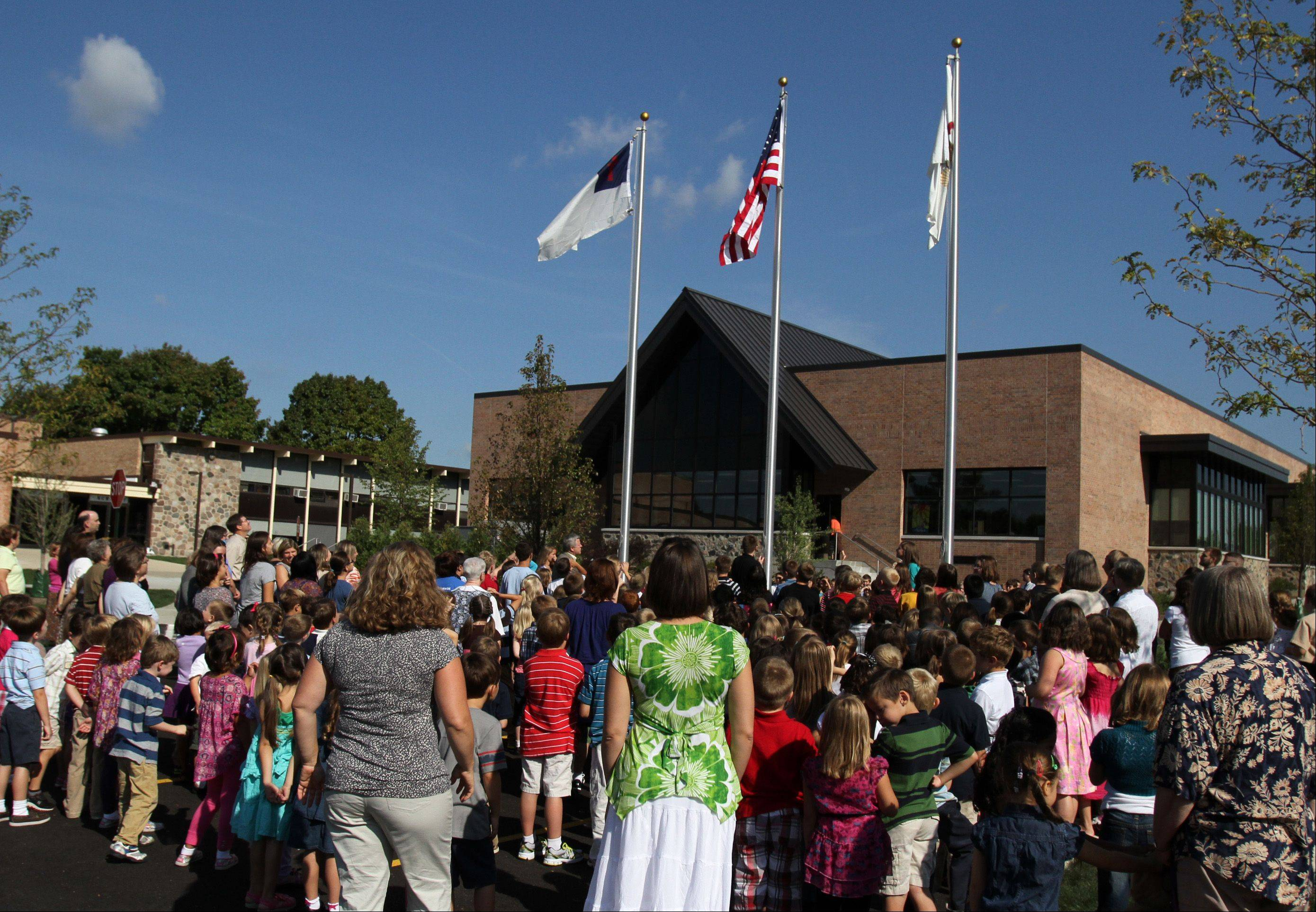 More than 500 students and faculty gathered in front of St. Peter Lutheran School on Monday for a flag raising on the first day of school. Students also celebrated the opening of the school's new 17,000-square-foot wing that includes an assembly area and four new preschool rooms.