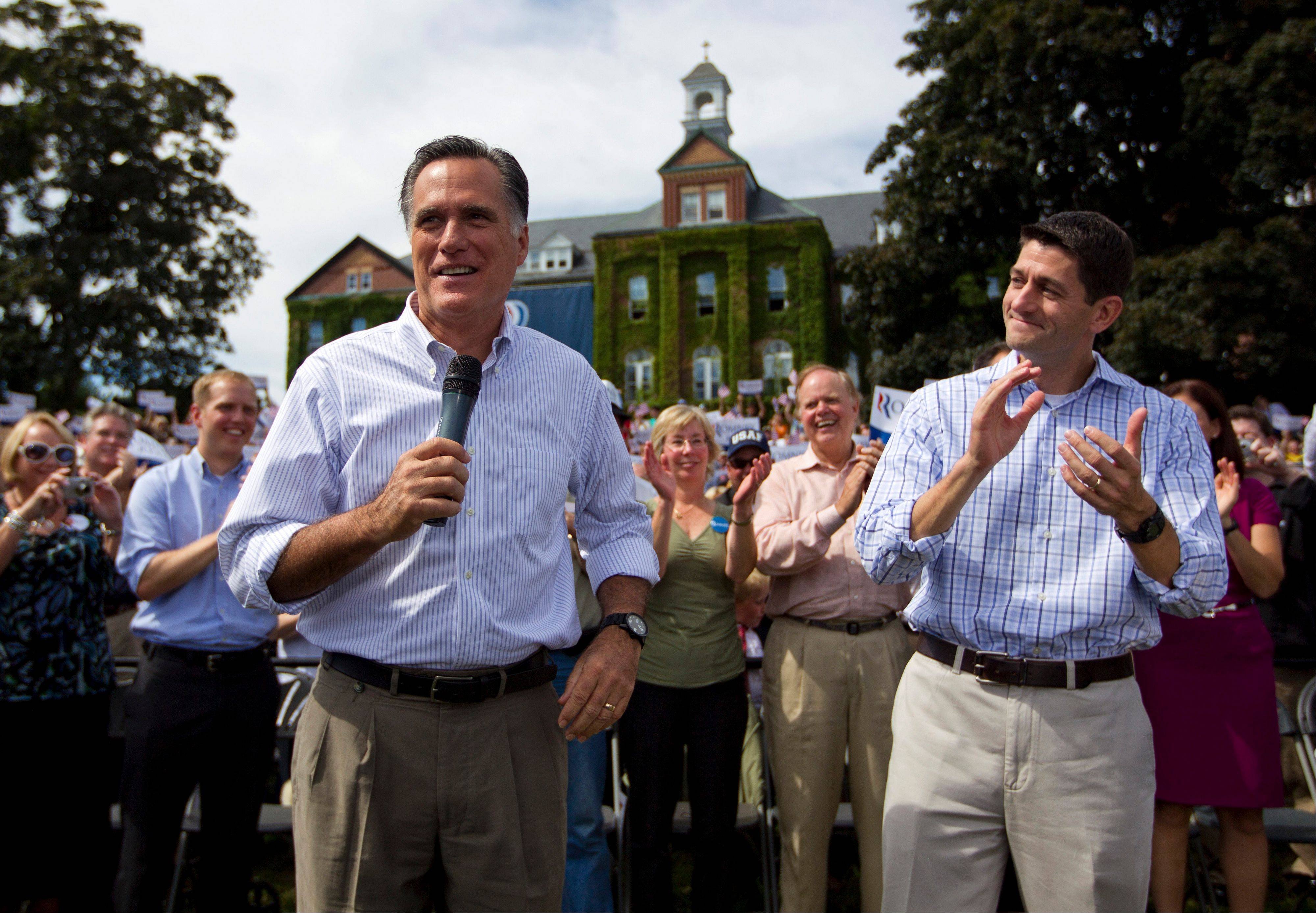 Republican vice presidential candidate, Rep. Paul Ryan, applauds at right as Republican presidential candidate, former Massachusetts Gov. Mitt Romney speaks during a campaign rally Monday in Manchester N.H.