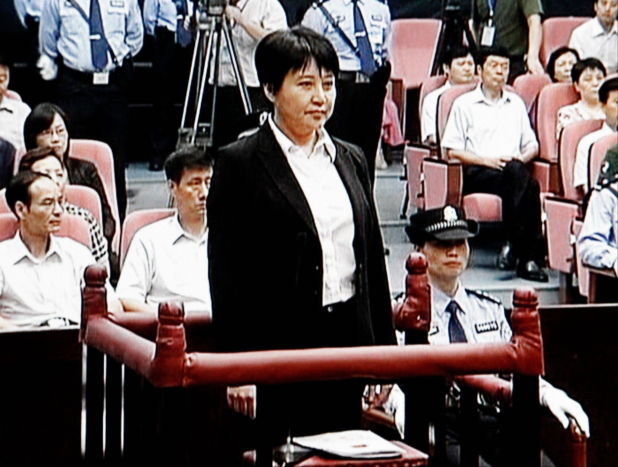 Gu Kailai, center, the wife of a disgraced Chinese politician, was given a suspended death sentence Monday after confessing to killing a British businessman by poisoning him with cyanide in a case that rocked the country's top political leadership.