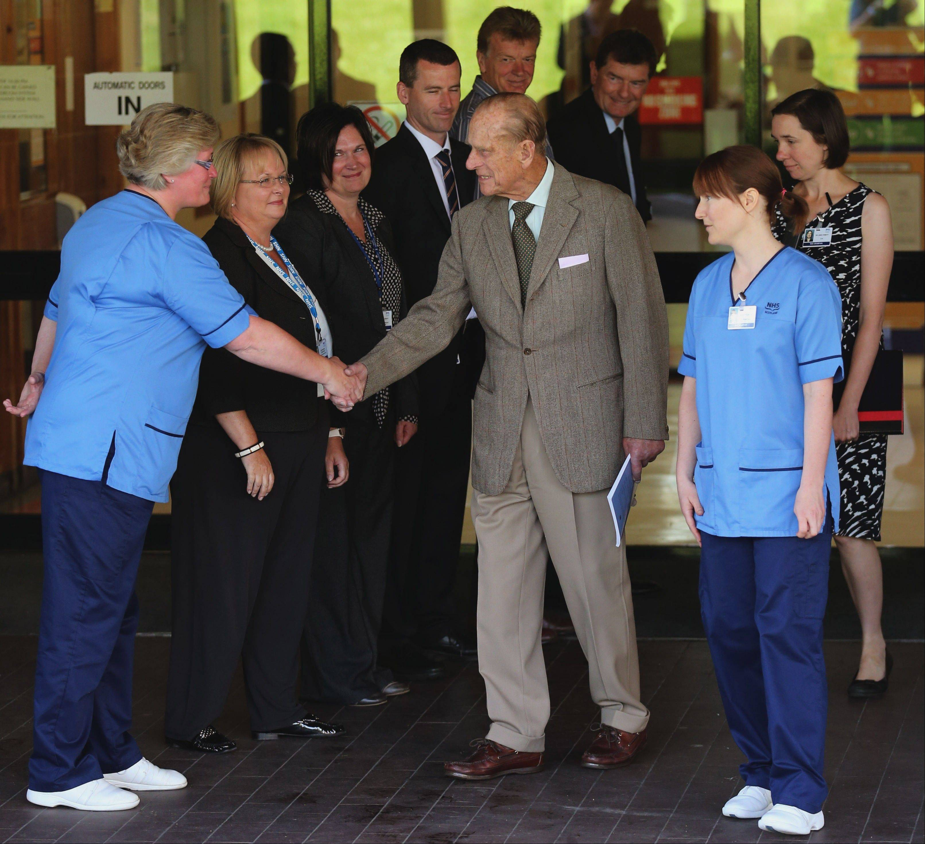 Britain's Prince Philip thanks hospital staff as he leaves Aberdeen Royal Infirmary in Aberdeen, Scotland, on Monday after five days of treatment for a bladder infection.