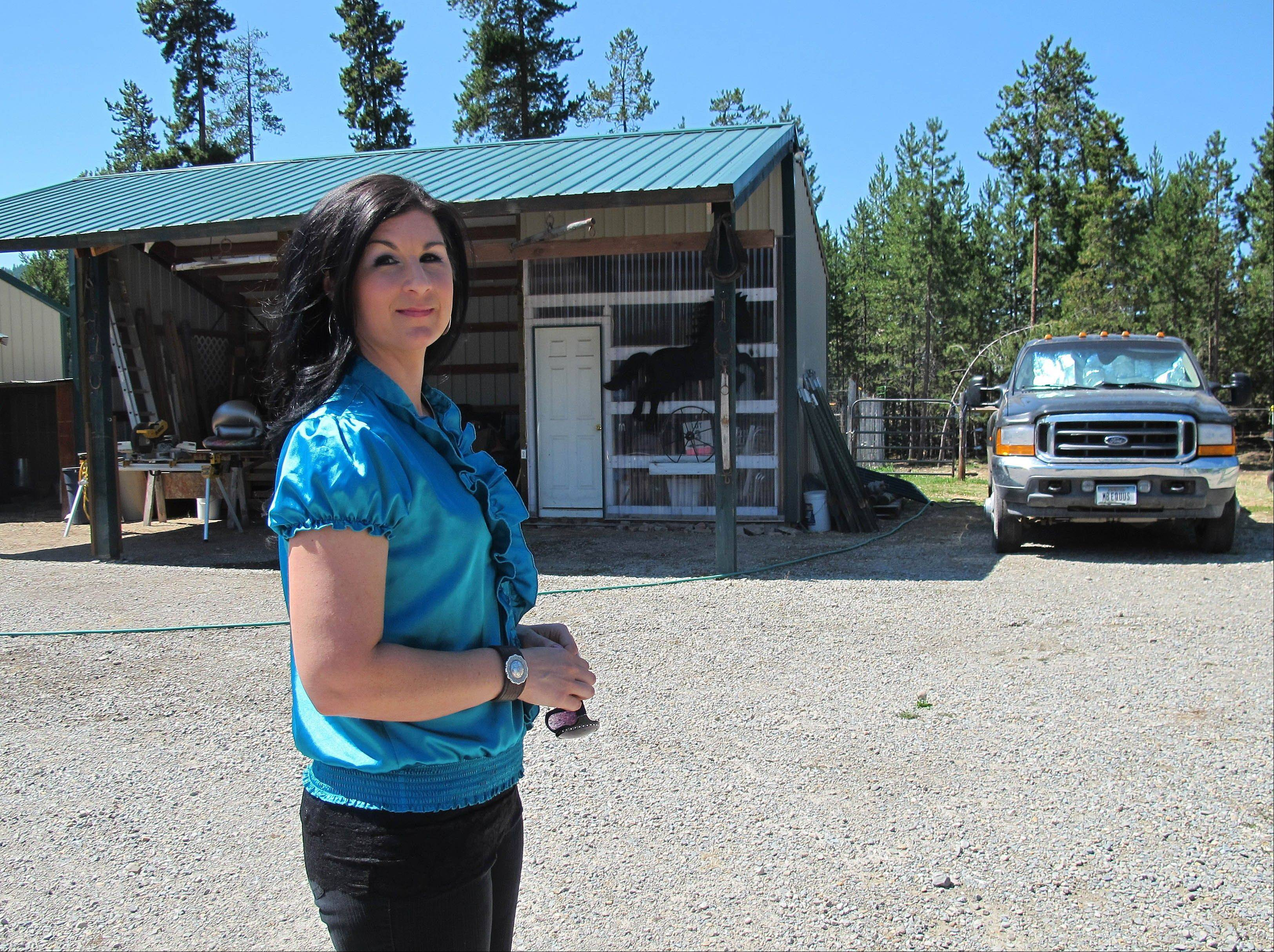Sara Weaver stands outside her horse ranch near Kalispell, Mont. Weaver has finally forgiven the federal agents who 20 years ago shot her mother and younger brother to death during the siege at Idaho's Ruby Ridge.