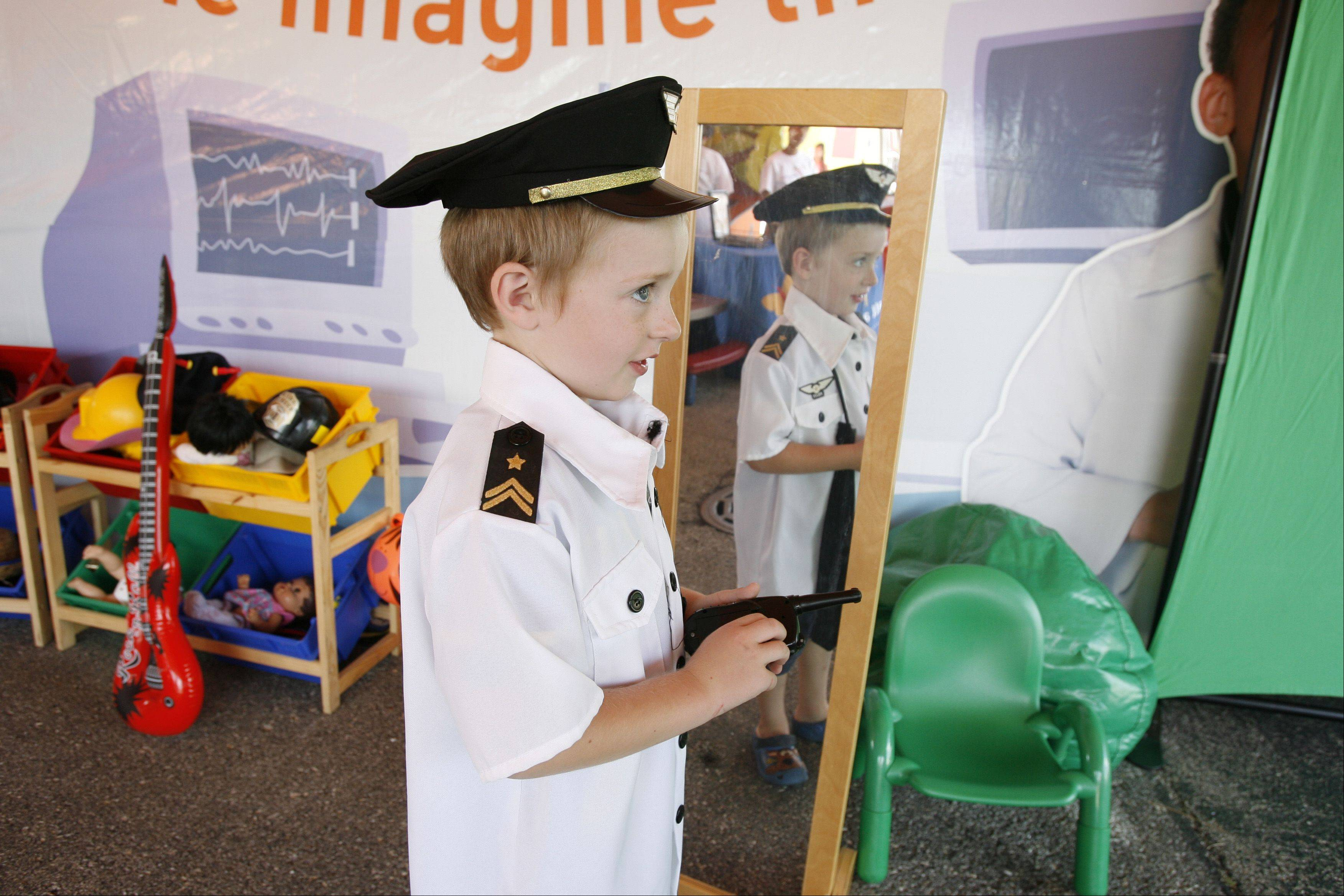 "Jakob Snyder, 4, of Wheaton dresses as his favorite pilot, during the ""Learning is All Around Me"" program at the DuPage Children's Museum."