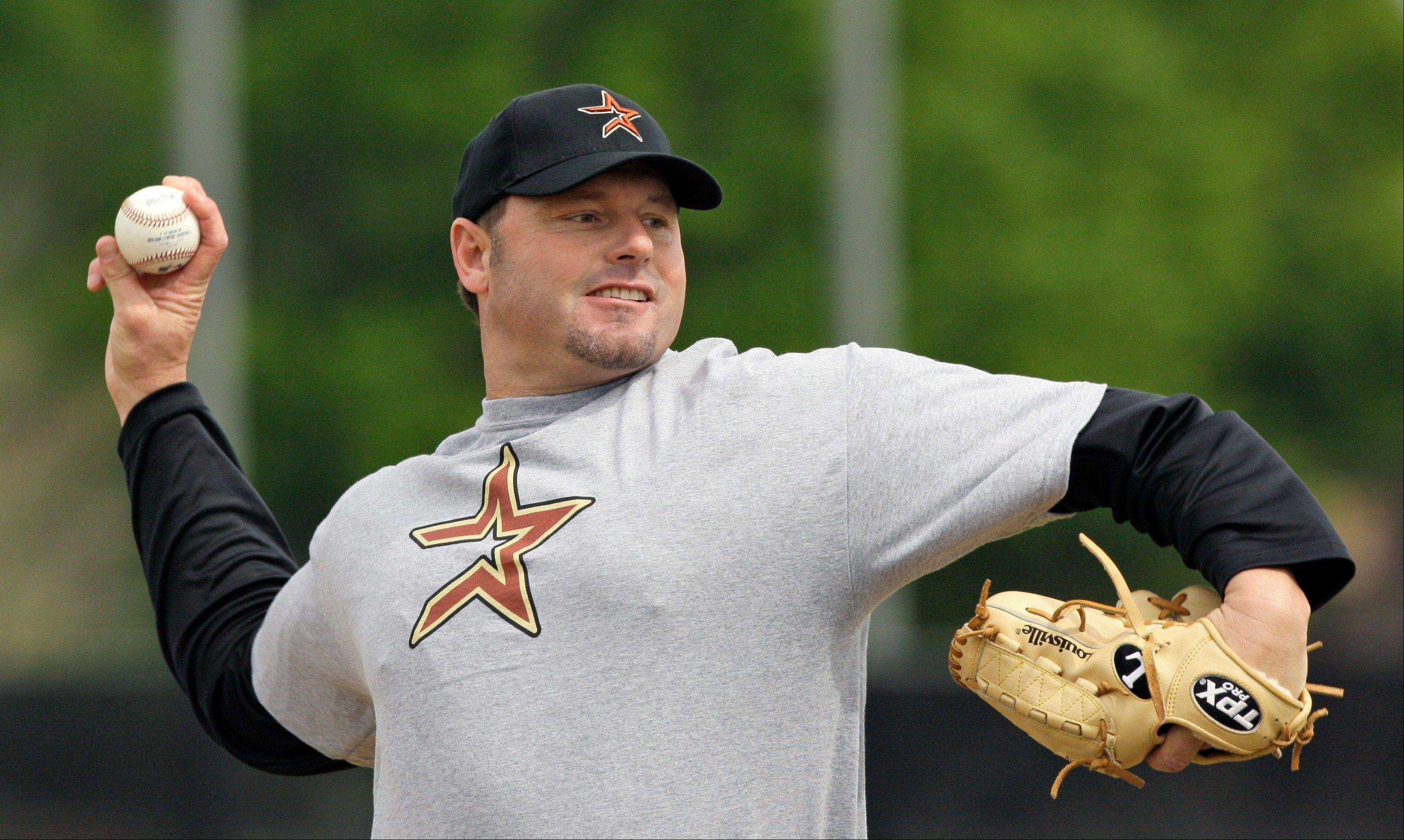 This Feb. 27, 2008 file photo shows Roger Clemens throwing a pitch during batting practice at the Houston Astros minor league spring training facility in Kissimmee, Fla. Clemens has signed with the Sugar Land Skeeters of the independent Atlantic League and is expected to start for them on Saturday at home against Bridgeport.