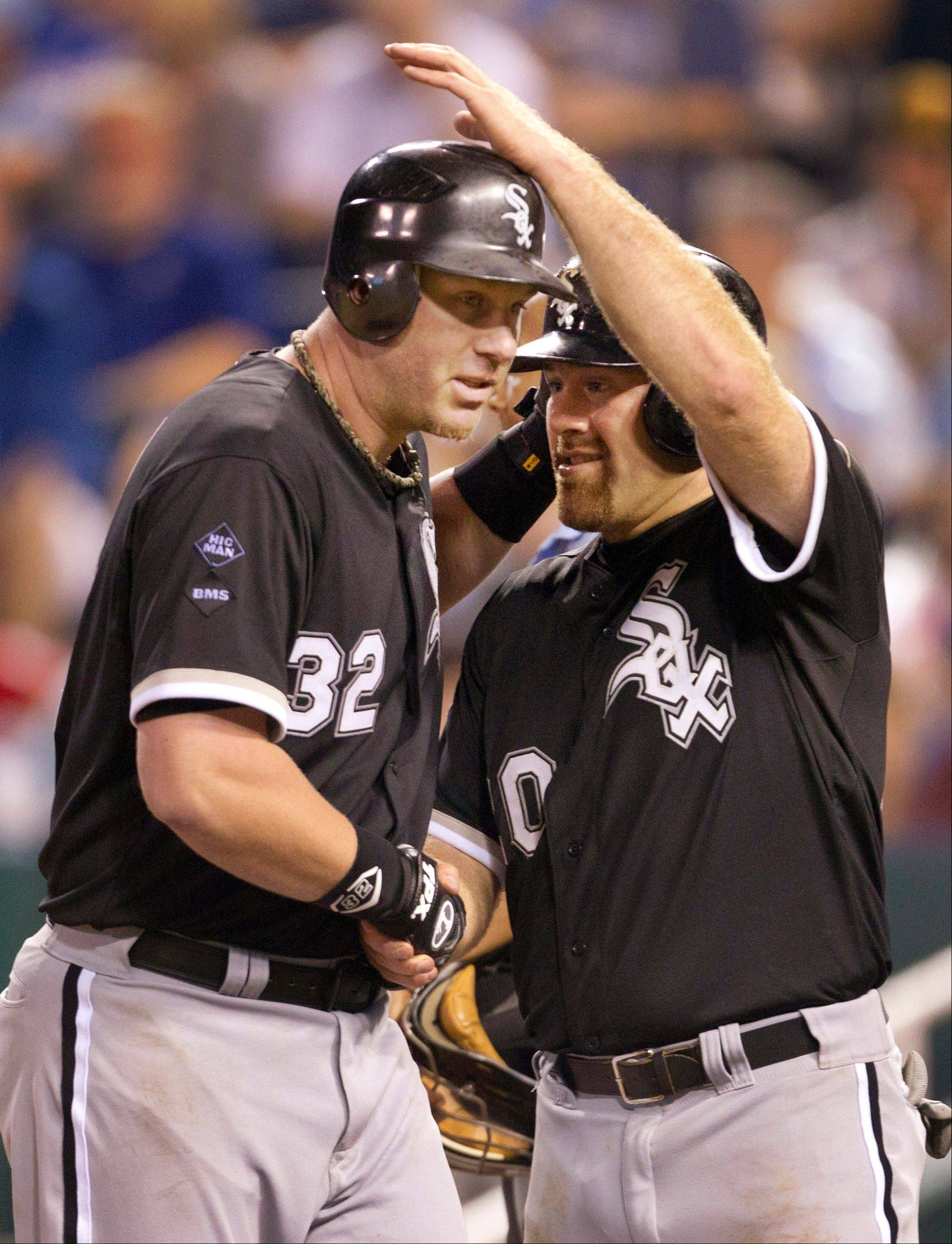 Adam Dunn, left, is congratulated by White Sox teammate Kevin Youkilis after hitting career home run No. 400 on Saturday.
