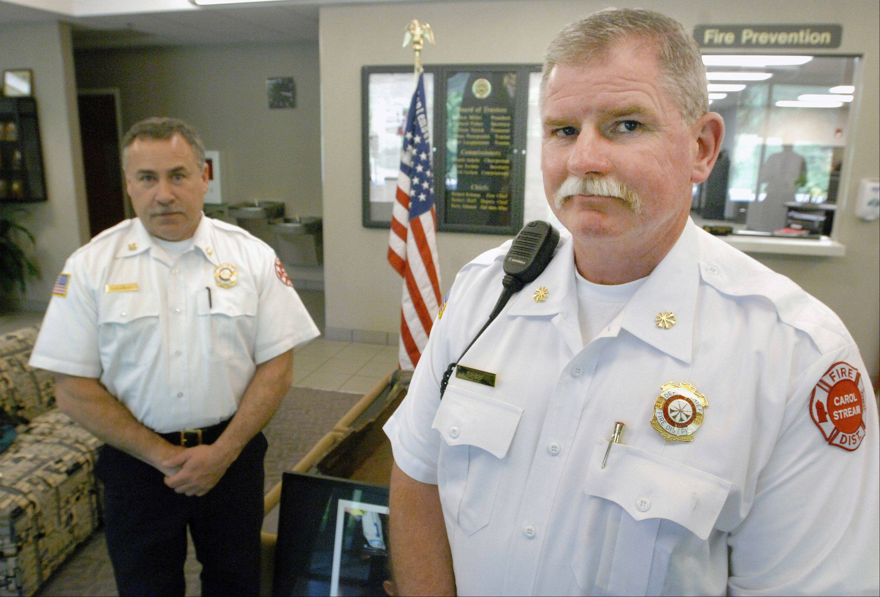 New Carol Stream Deputy Fire Chief Bob Hoff, right, was hired in February as part of a district leadership reorganization plan by Fire Chief Rick Kolomay. Critics on the fire district board suggested Kolomay was molding the position for Hoff, who stepped down two weeks before as Chicago Fire Department commissioner.