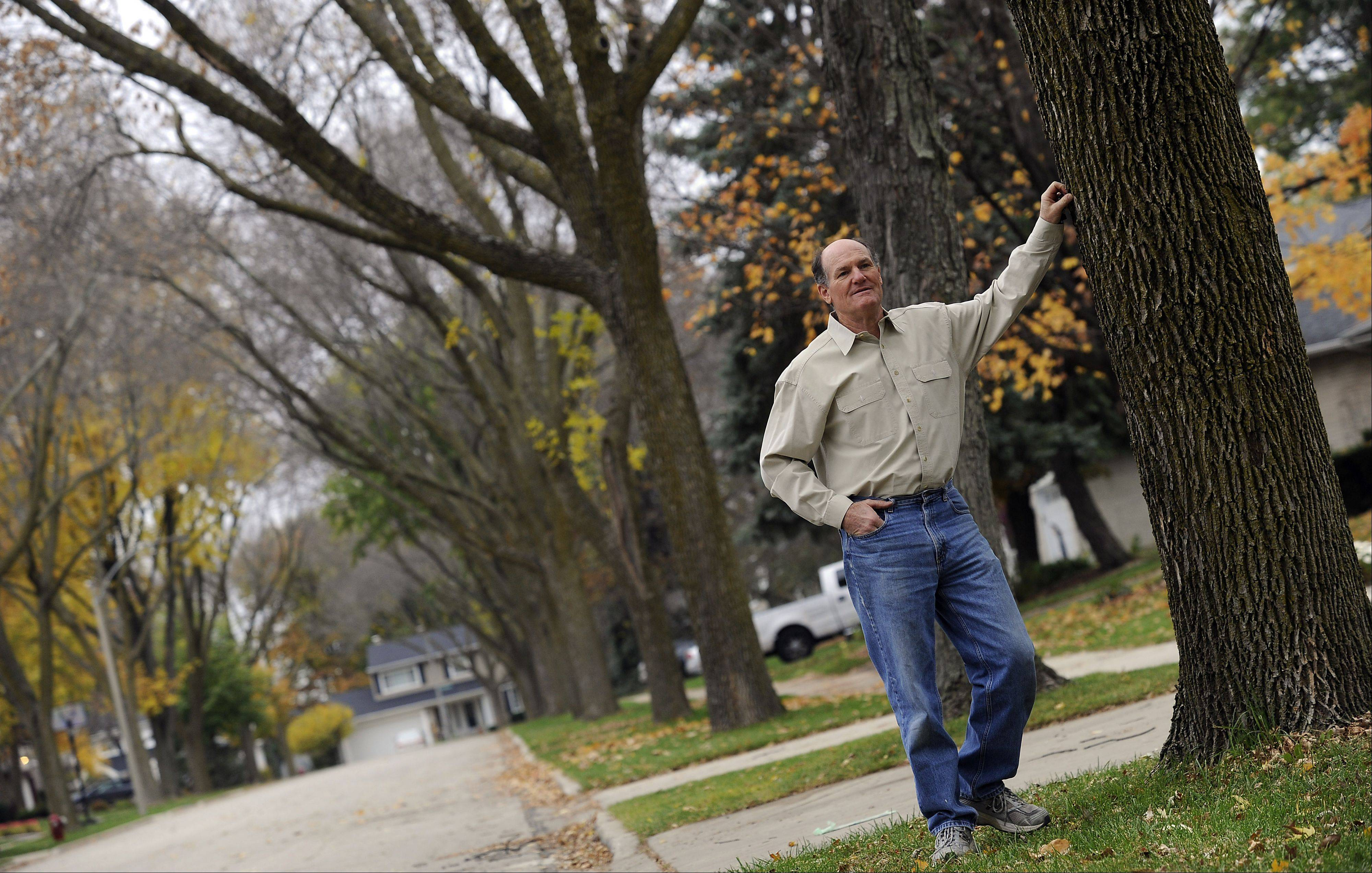 Sam Moser led the campaign in his Arlington Heights neighborhood to treat their ash trees.