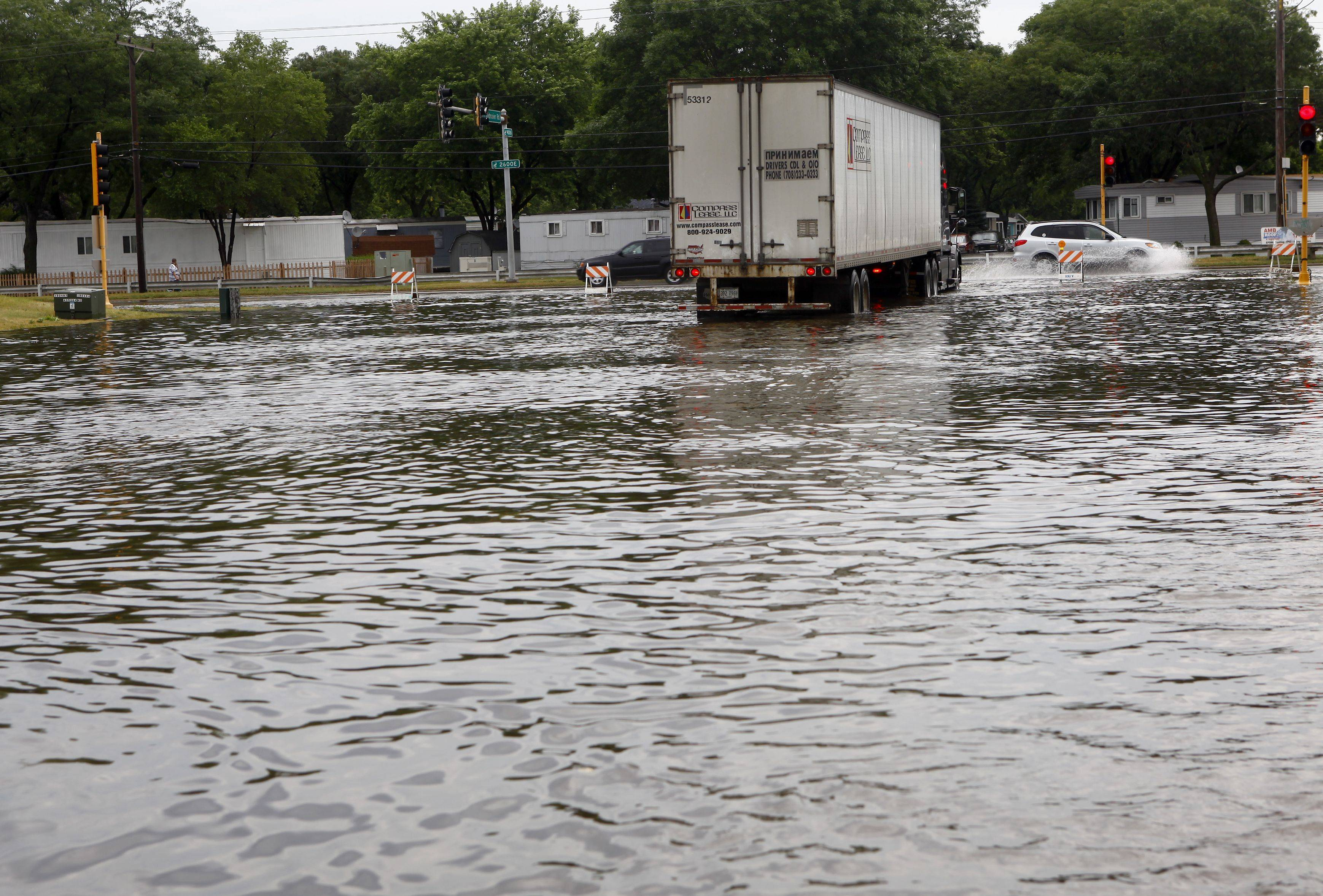 Excessive rains battered the suburbs in July 2011, shutting down arterials like Landmeier Road in Des Plaines.