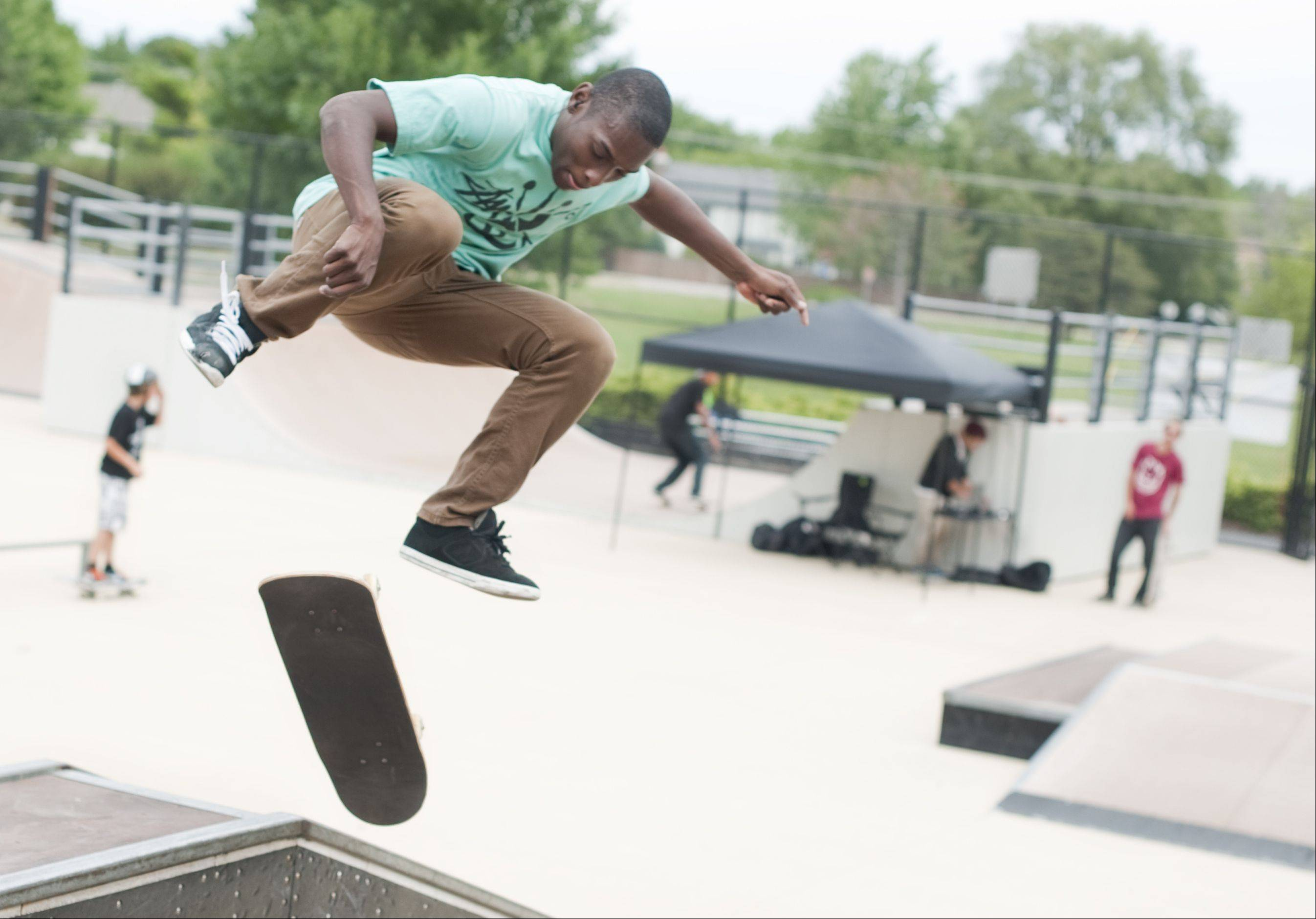 Marcell Purham of Wheaton attempts a board flip at the BMX and Skateboard Contest hosted by the Geneva Park District at the 1800 South Street skate park in Geneva Sunday. Purham placed first in the intermediate level competition as well as best trick competition.