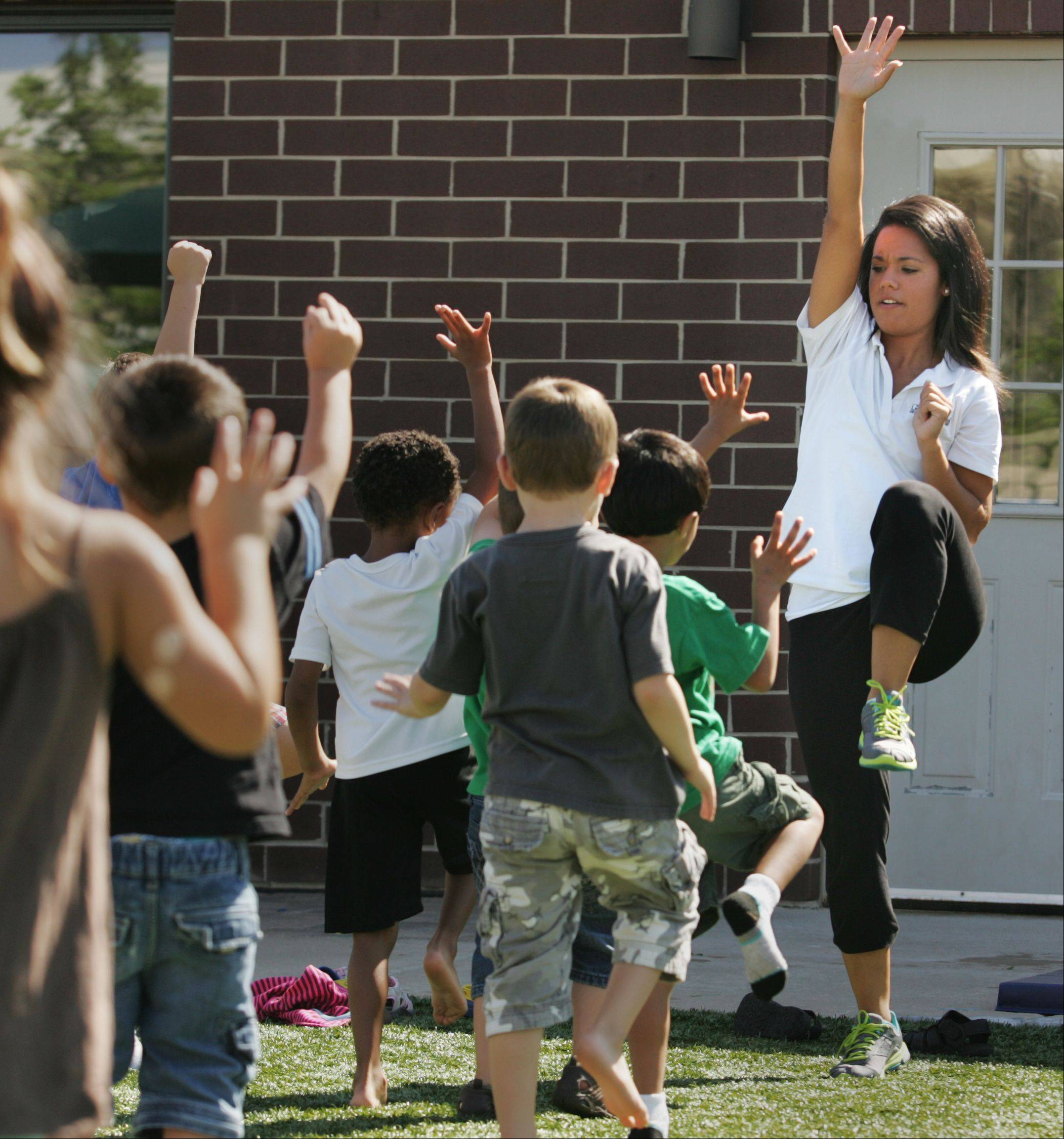 New physical education teacher Nichole Vittorino works with young students at the Goddard School in Elgin. Vittorino, 25 from Gilberts, is the first PE teacher at over 300 Goddard School locations across the country.