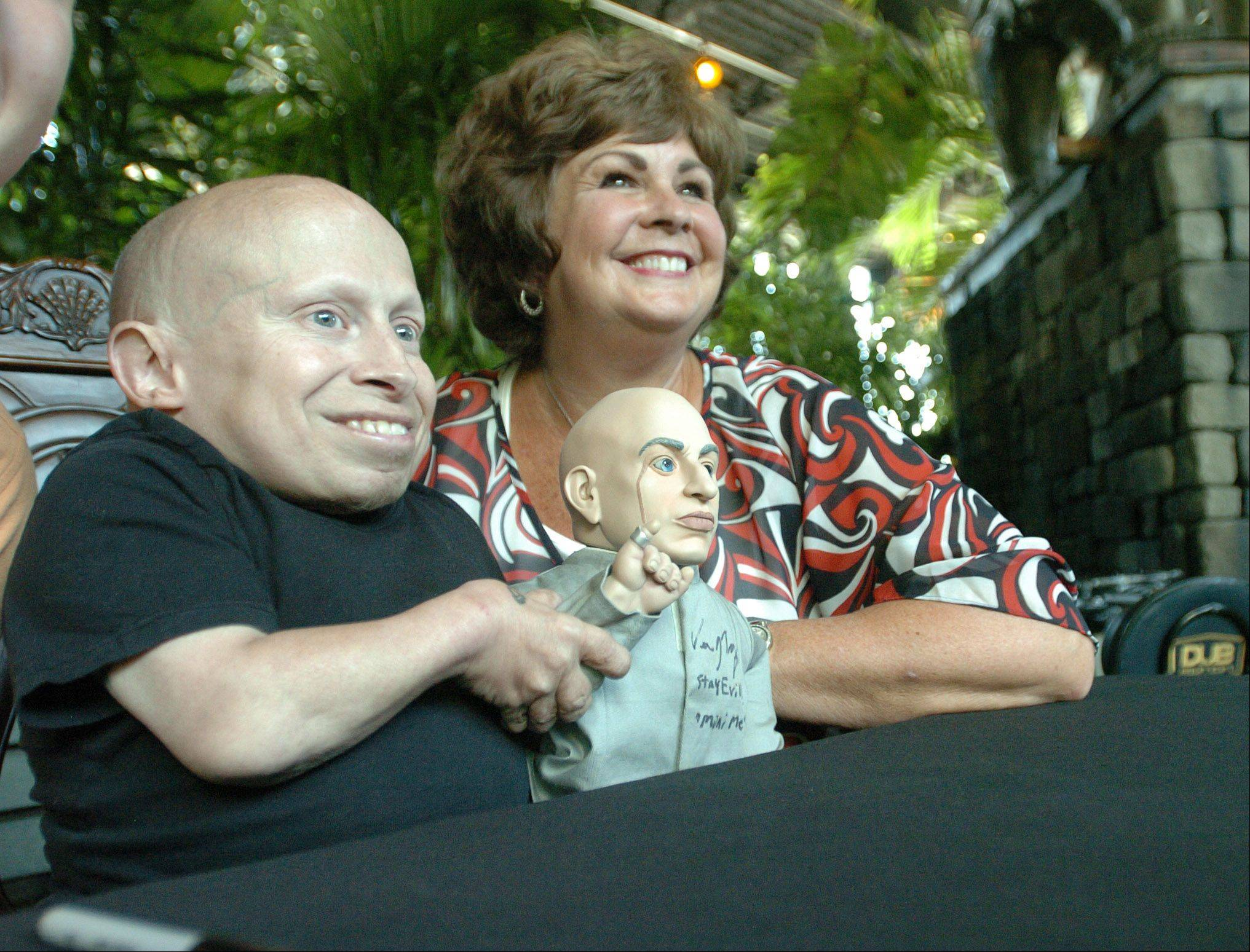 "Actor Vern Troyer, who played ""Mini Me"" in the Austin Powers movie series signed autographs at Hollywood Palms in Naperville Saturday. He was posing for photographs with Jan Baumgartner of Naperville in this photo. She waited over two hours to get her photo taken with him."