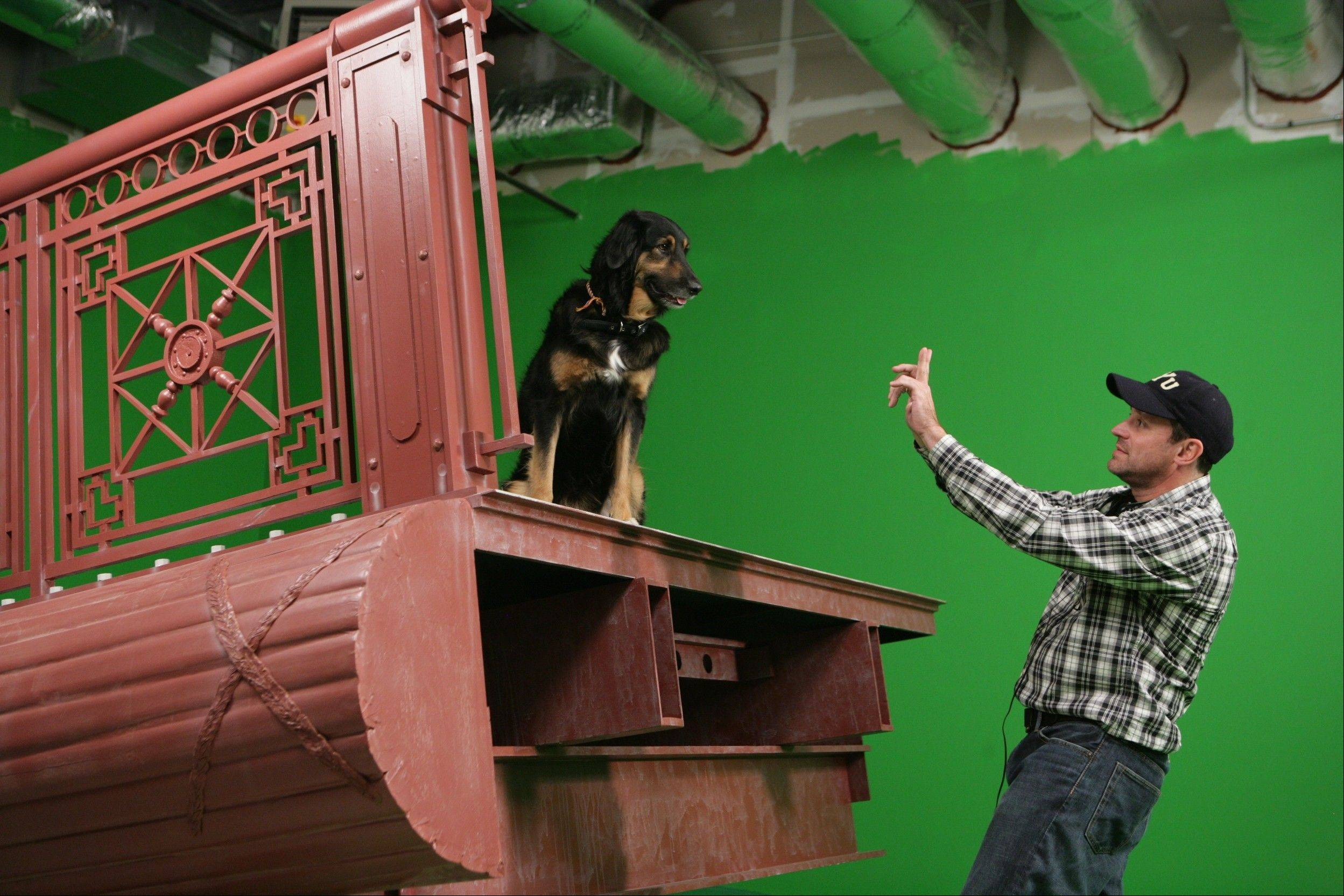 "Kevin Cooper, 45, of Wheaton, directs a scene in ""I Heart Shakey,"" the family comedy filmed mostly in the suburbs. They used a green screen and re-created Chicago's DuSable bridge rather than filming the scenes downtown."