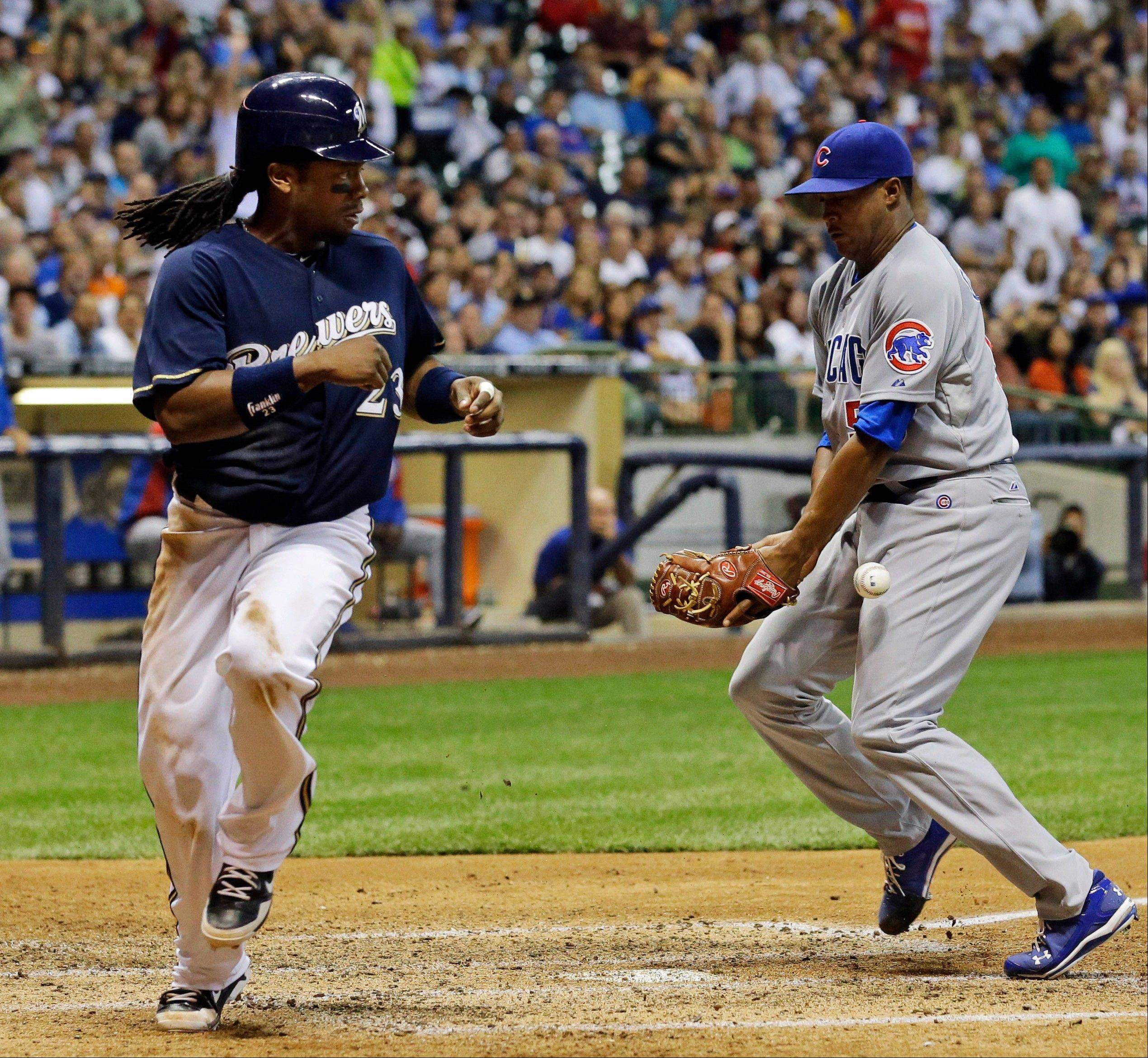 Milwaukee Brewers' Rickie Weeks scores from third on a wild pitch as Chicago Cubs relief pitcher Alberto Cabrera cannot handle the throw during the sixth inning of a baseball game, Tuesday in Milwaukee.