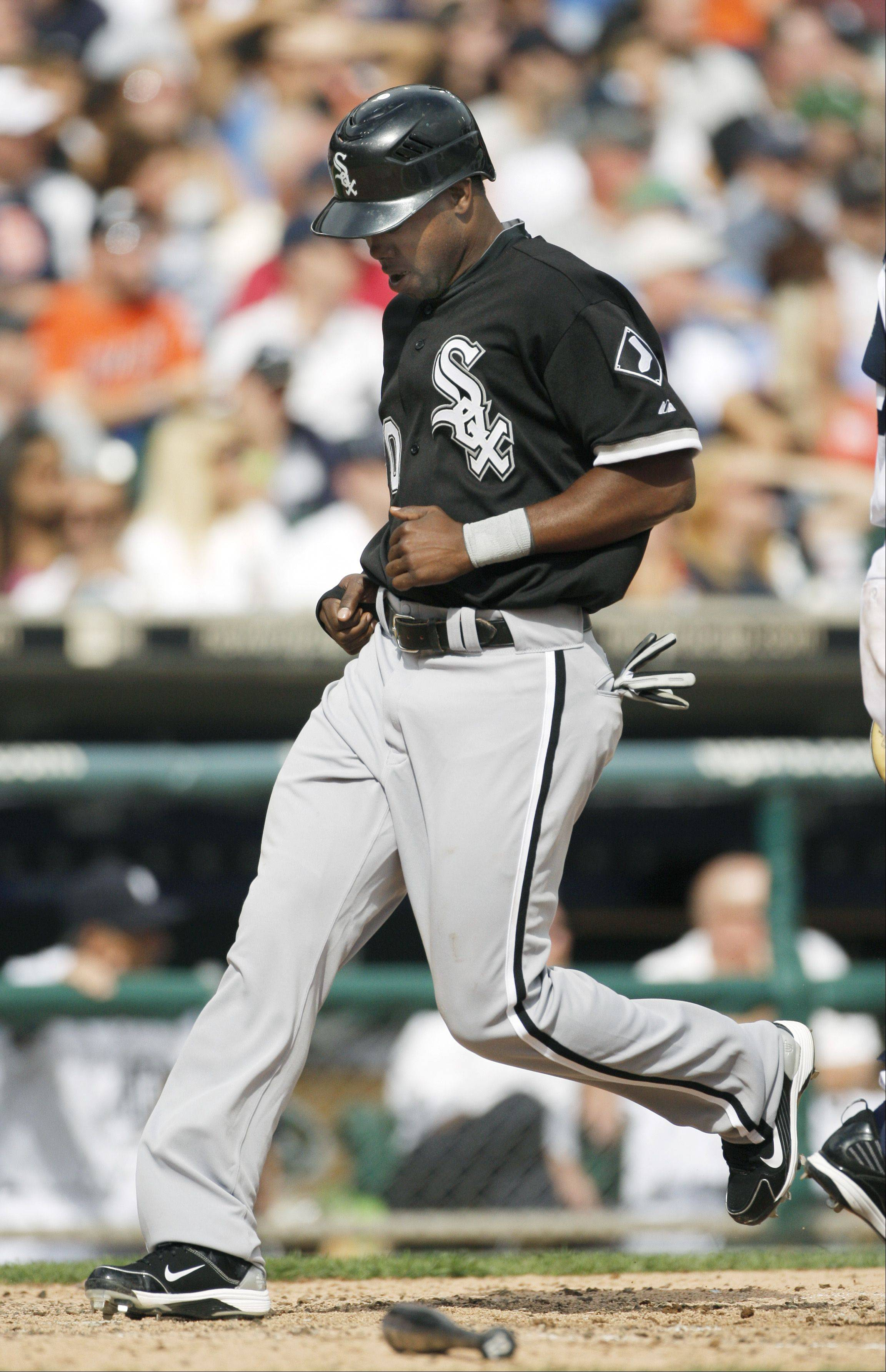 Chicago White Sox's Alejandro De Aza, pinch running for Manny Ramirez, scores the go-ahead run from third base on a single by A.J. Pierzynski in the 10th inning of a baseball game against the Detroit Tigers Monday, Sept. 6, 2010 in Detroit. The White Sox defeated the Tigers 5-4 in 10 innings. (AP Photo/Duane Burleson)