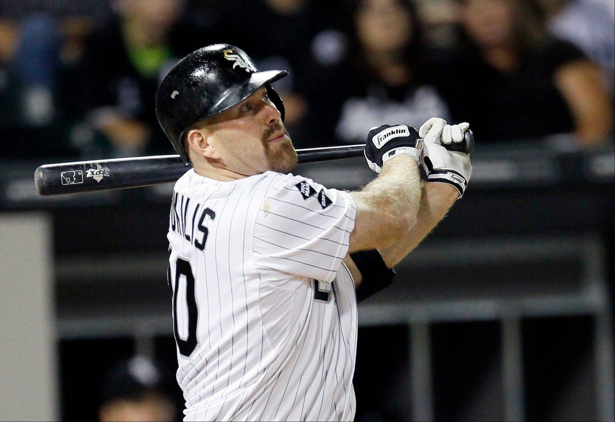 Chicago White Sox's Kevin Youkilis hits a grand slam off a pitch by New York Yankees' Ivan Nova during the fifth inning of a baseball game, Tuesday, Aug. 21, 2012, in Chicago. Also scoring on the play was Alexei Ramirez, Gordon Beckham, and Dewayne Wise. (AP Photo/Charles Rex Arbogast)