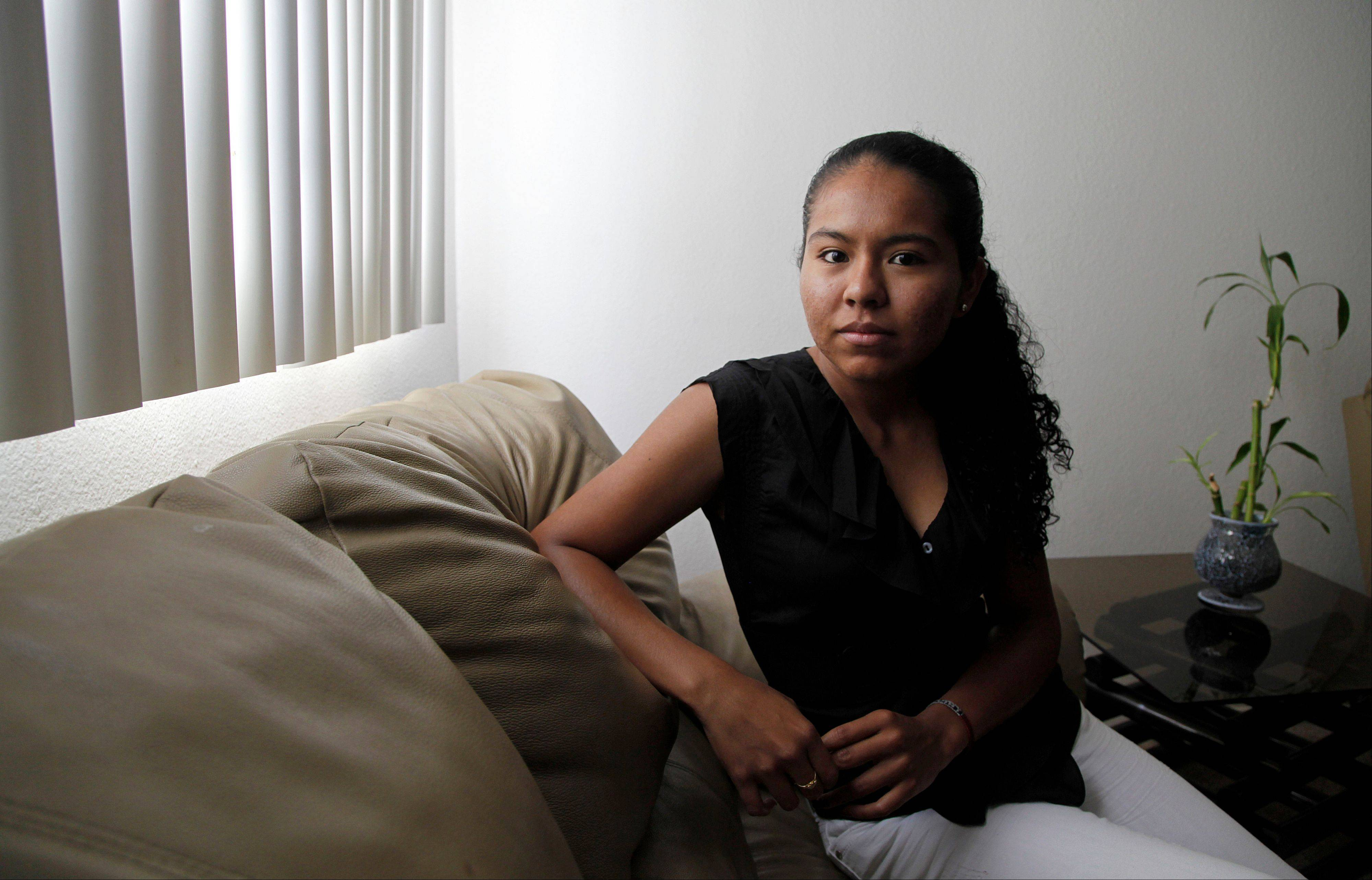 Araceli Cortes, an illegal immigrant who wants to go to medical school, is shown at her home in the Los Angeles-area suburb of Canyon Country, Calif. Cortes had made up her mind to return to Mexico to pursue her dream of becoming a doctor. She quit her job, purchased an airline ticket and reserved a seat to take a medical school entrance exam. Then, a week before her departure, President Barack Obama announced that young illegal immigrants like Cortes would be given the chance to remain in the United States and obtain a work visa. Cortes canceled her ticket and decided to stay. But sheís still having second thoughts.