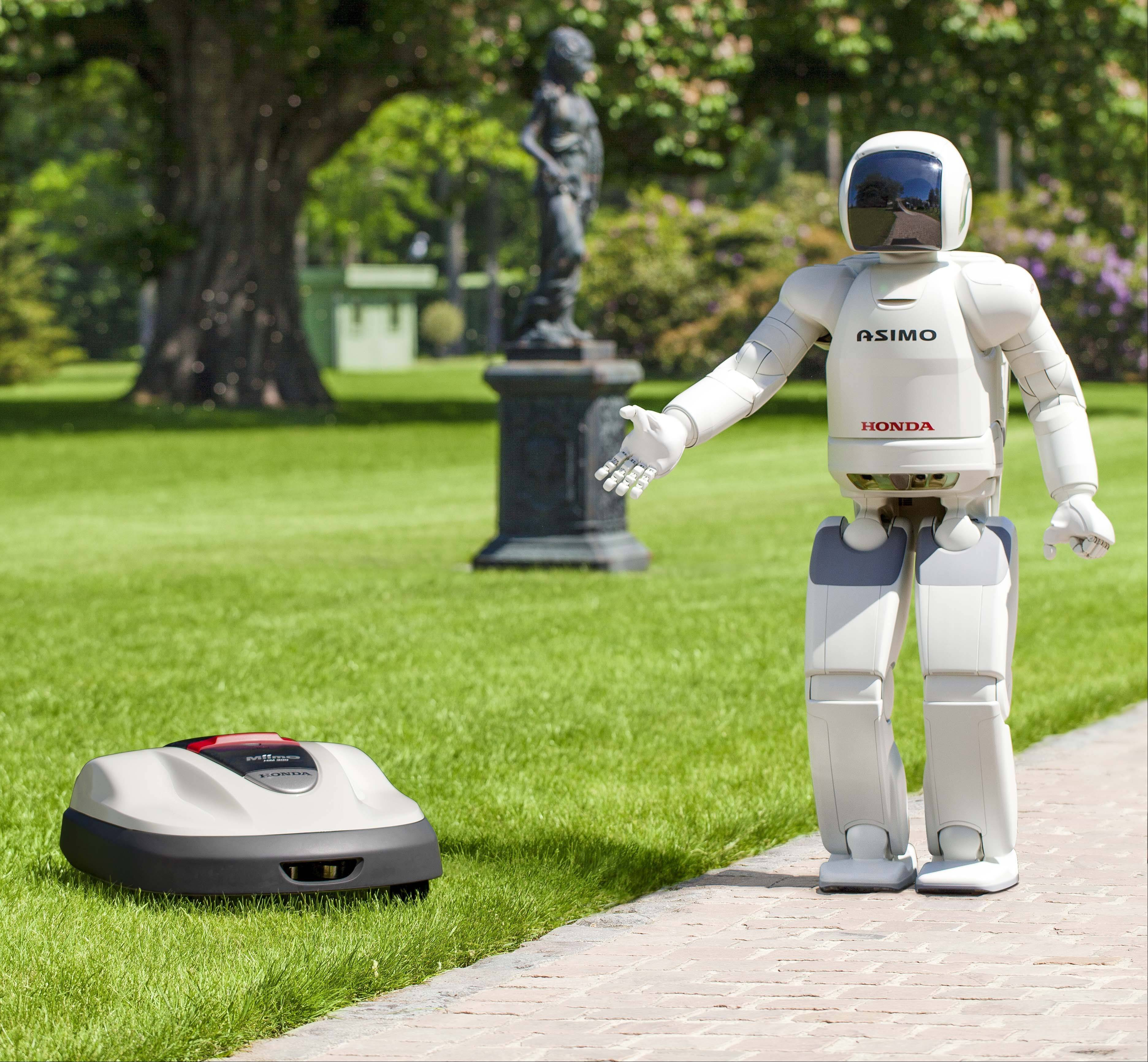 Asimo, Honda's walking talking robot shows its new product lawn mower Milmo.