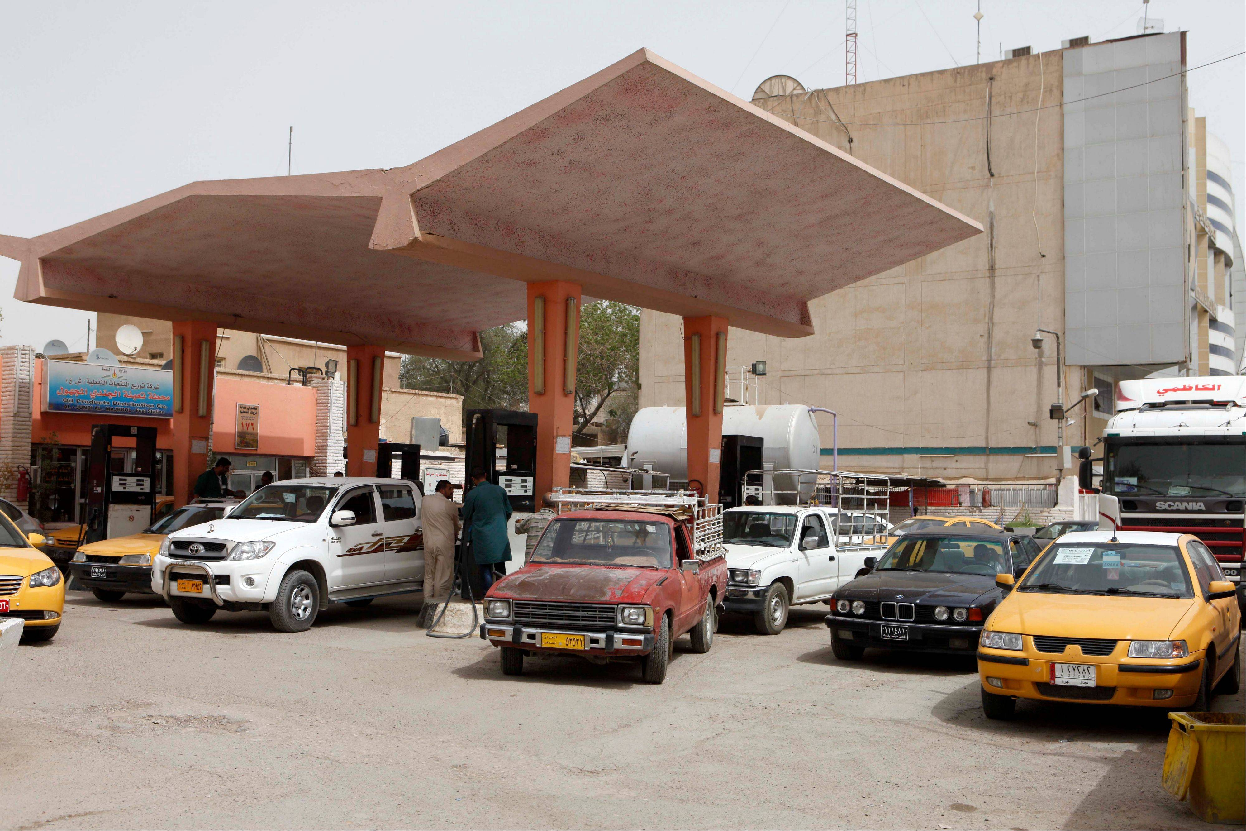 Iraqis fill up at a gas station in Baghdad, Iraq. Iraq is fast becoming an oil producing powerhouse.