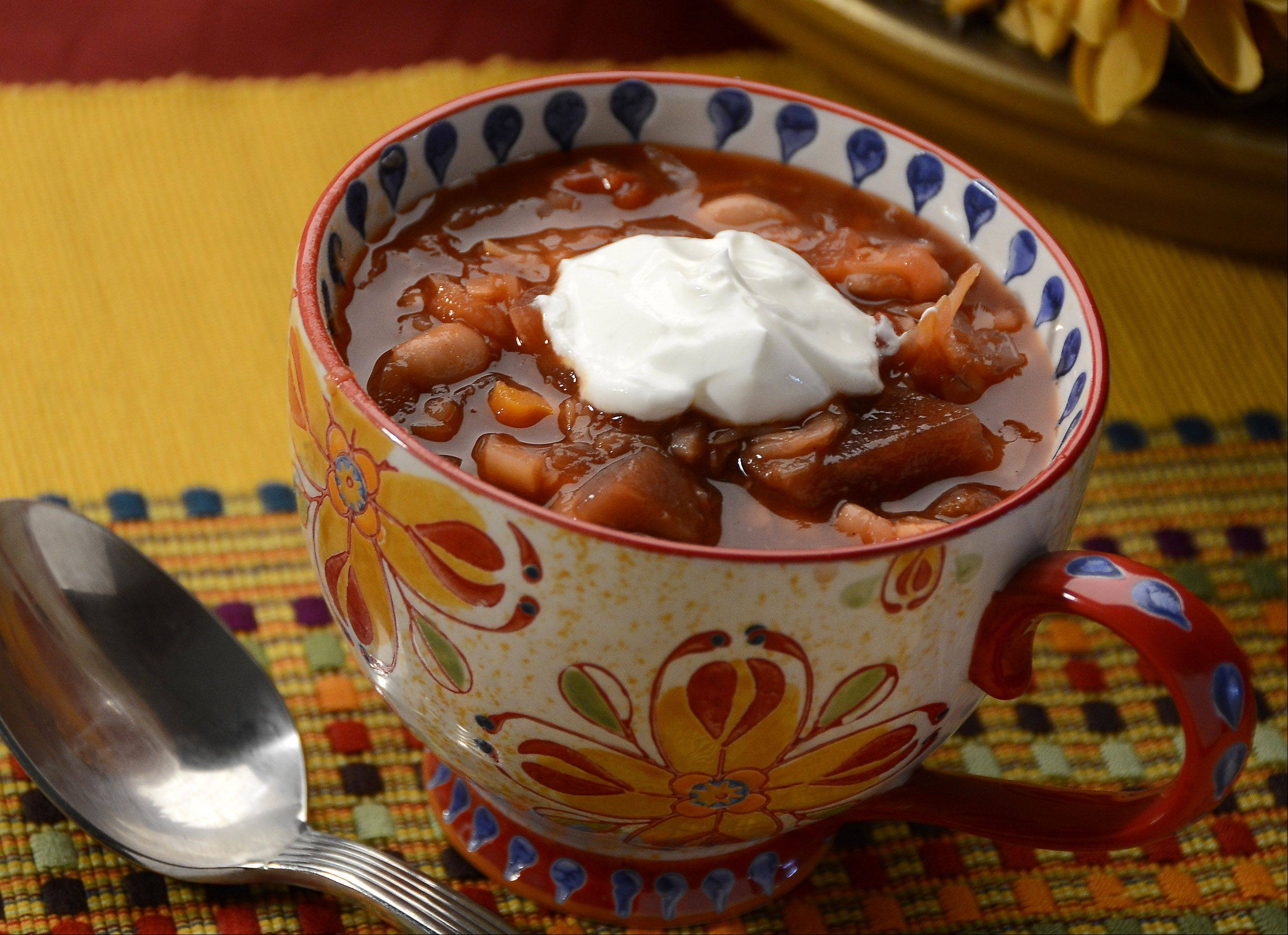 Borscht, an Eastern European soup that starts with cabbage and beets, can be served warm or cold.
