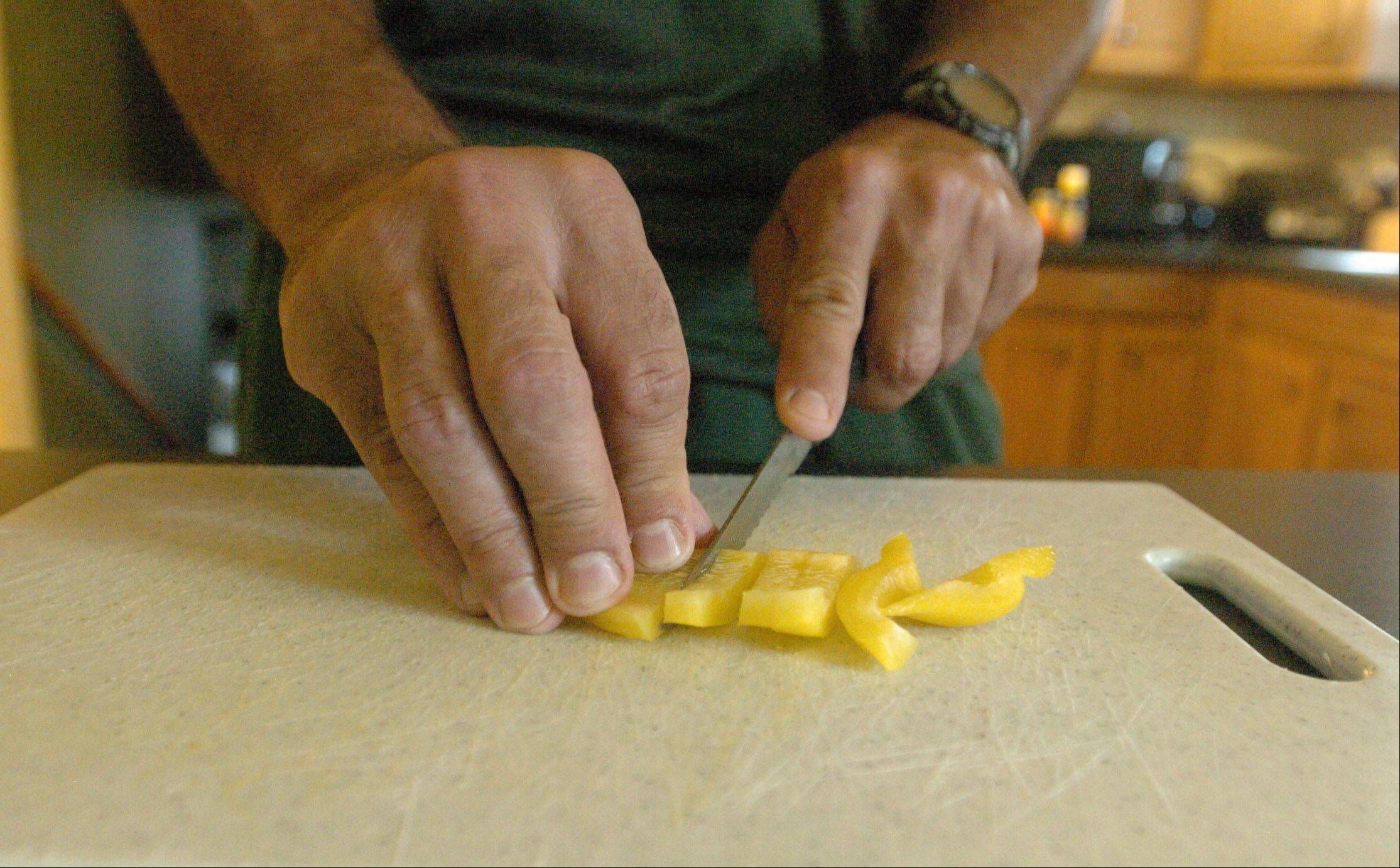 Jerry Roberts slices bell peppers for teriyaki turkey.