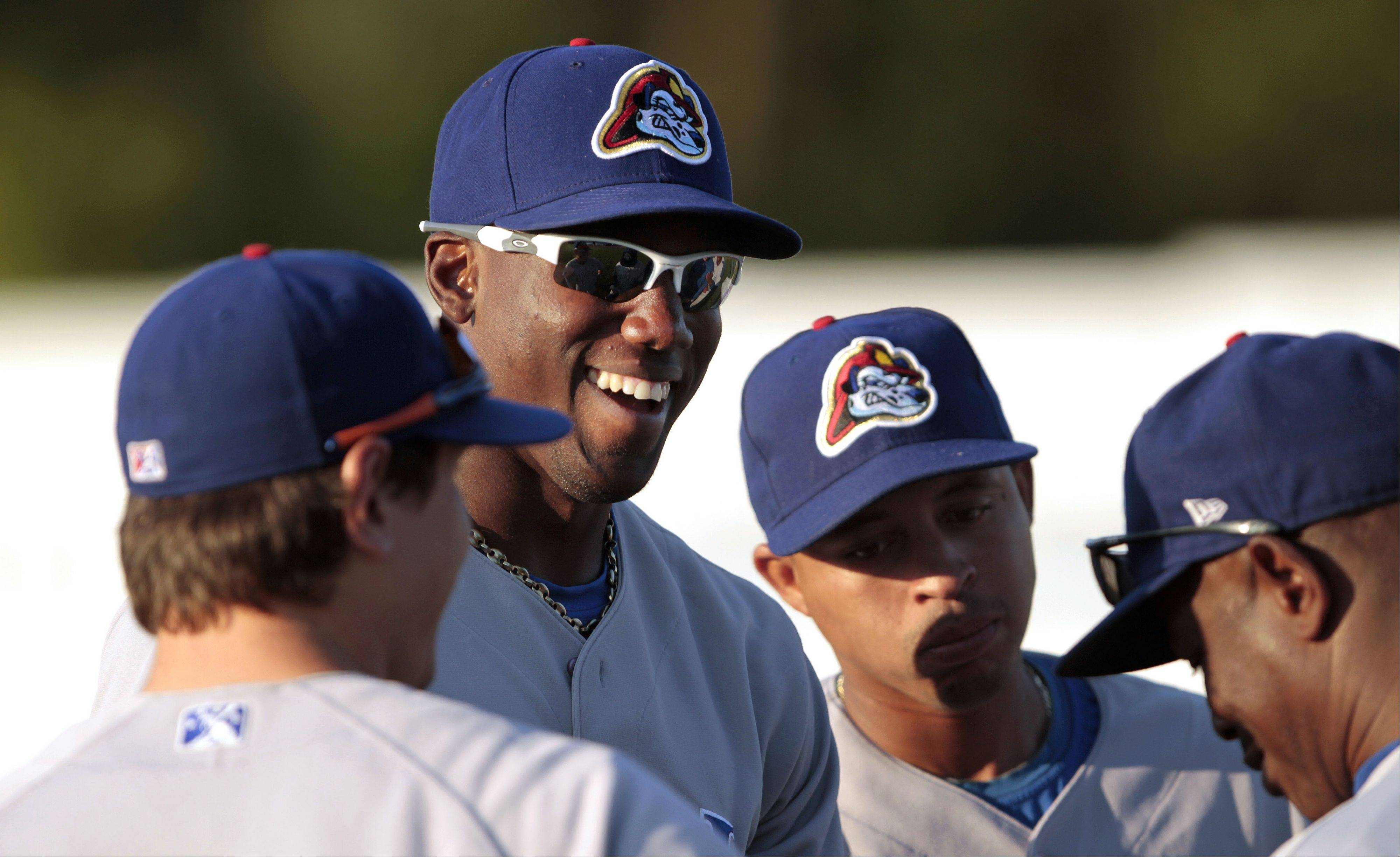 Cubs prospect Jorge Soler jokes with Peoria Chiefs teammates before a game with the Beloit Snappers. A report by the Chicago Sun-Times says say the Cubs Class A team may be moving to Kane County, which would not re-sign with the Kansas City Royals.