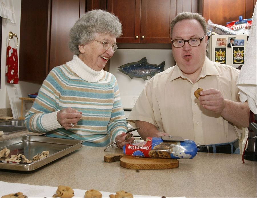 Marjorie Sullivan Lee and her son, Kevin, make chocolate chip cookies together in their Glen Ellyn home. Kevin shares in other household chores such as vacuuming and grocery shopping.