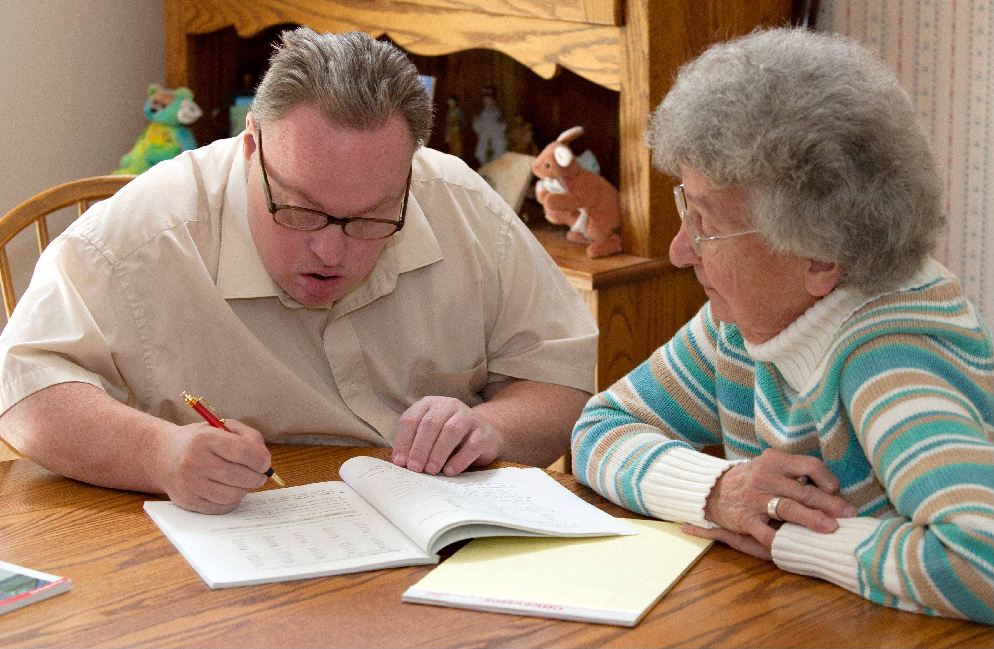 Marjorie Sullivan Lee helps Kevin with his reading. Kevin has many years of individualized reading credits at College of DuPage. Although Kevin doesn't read books, he has enough skills to read signs, ads, TV schedules and other materials that are part of daily life.