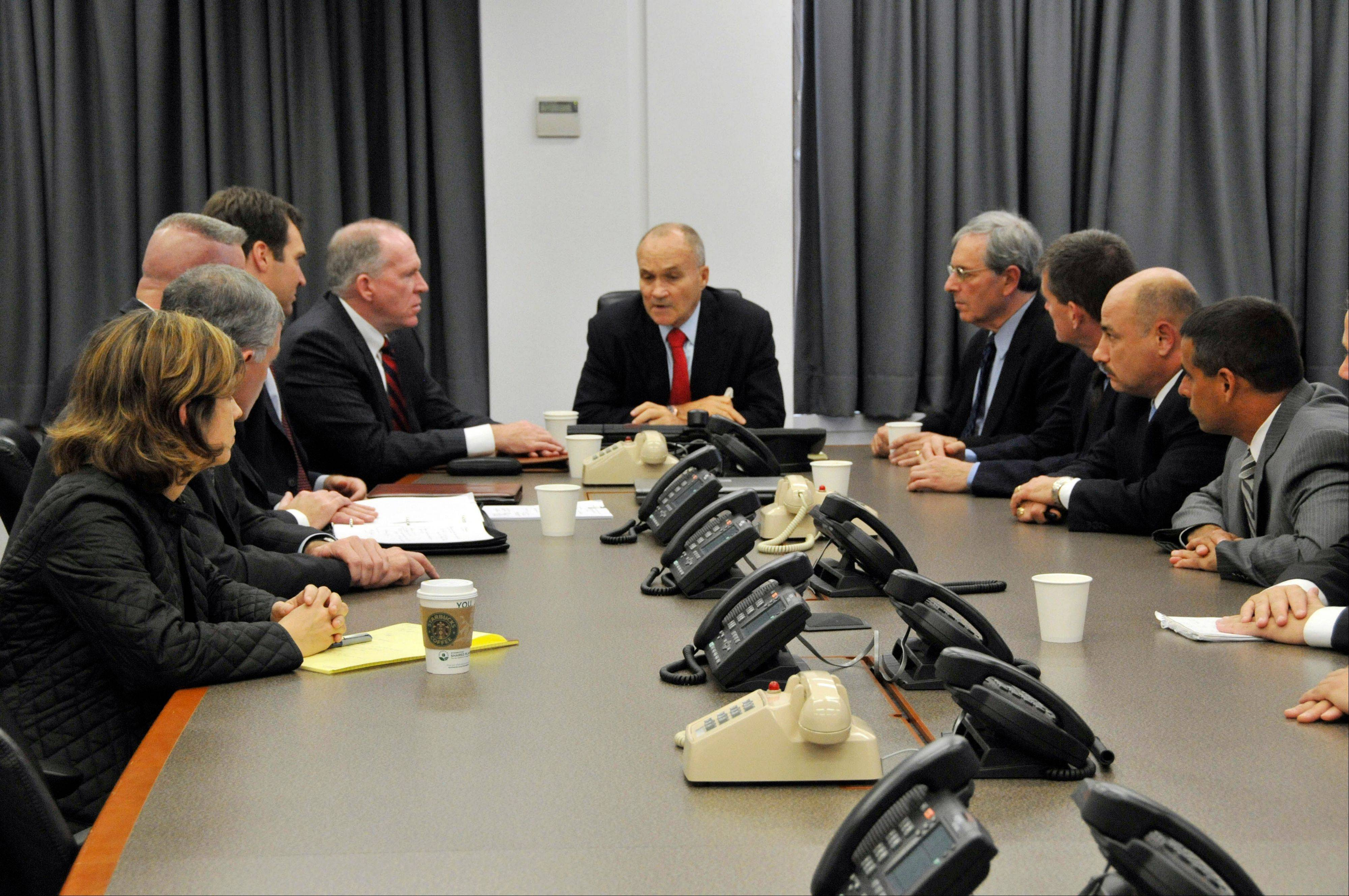 In this photo released by the New York City Police Department, NYC Police Commissioner Raymond Kelly, center, briefs other NYPD officials and John O. Brennan, assistant to the President for Homeland Security and Counterterrorism, center right, on events surrounding the alleged plot to bomb NYC commuter trains on Sept. 11, at Police Headquarters in New York, Saturday, Sept. 26, 2009.