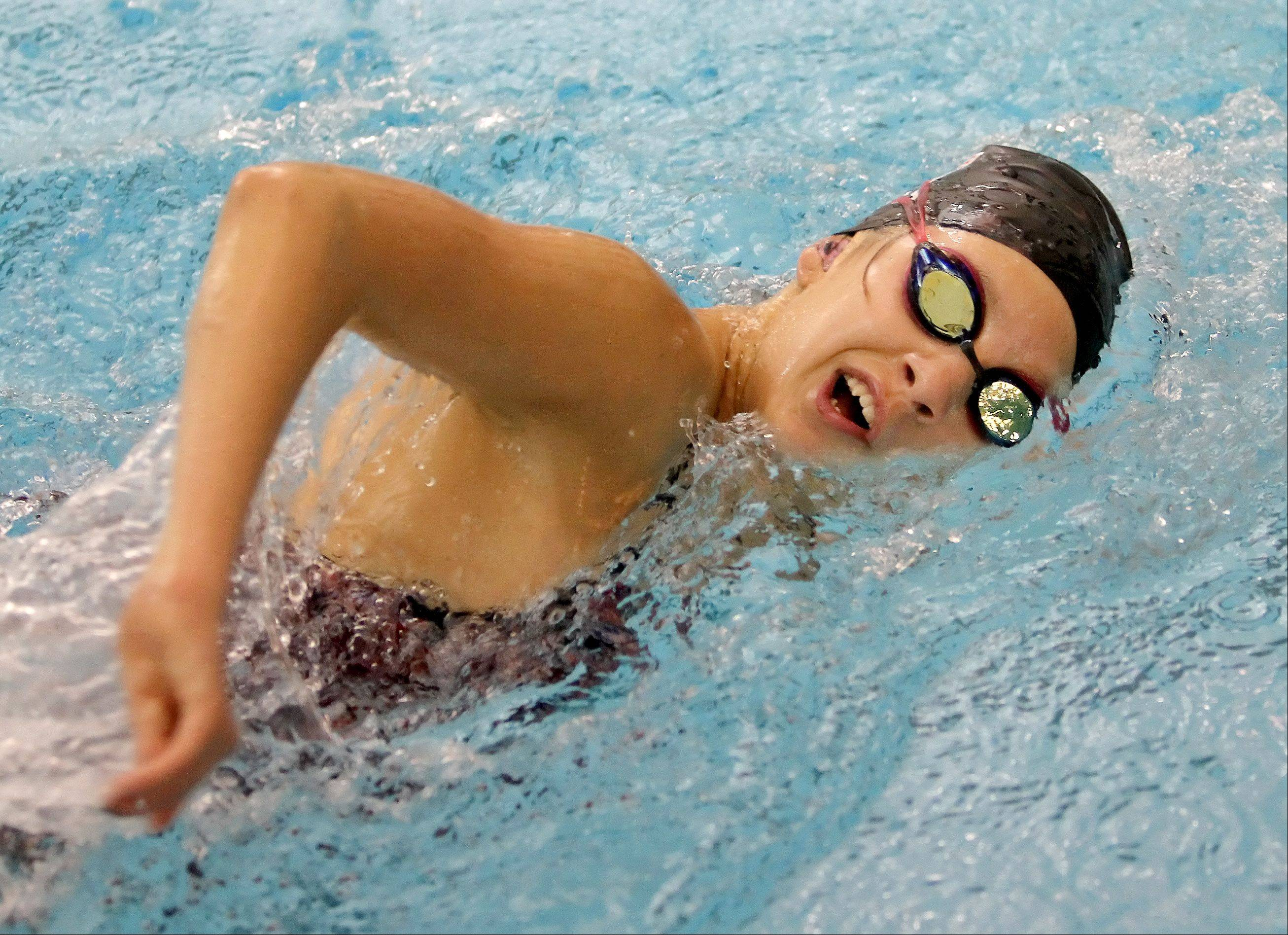 Alyssa Gialamas of Naperville trains at the Waubonsie Valley High School pool.