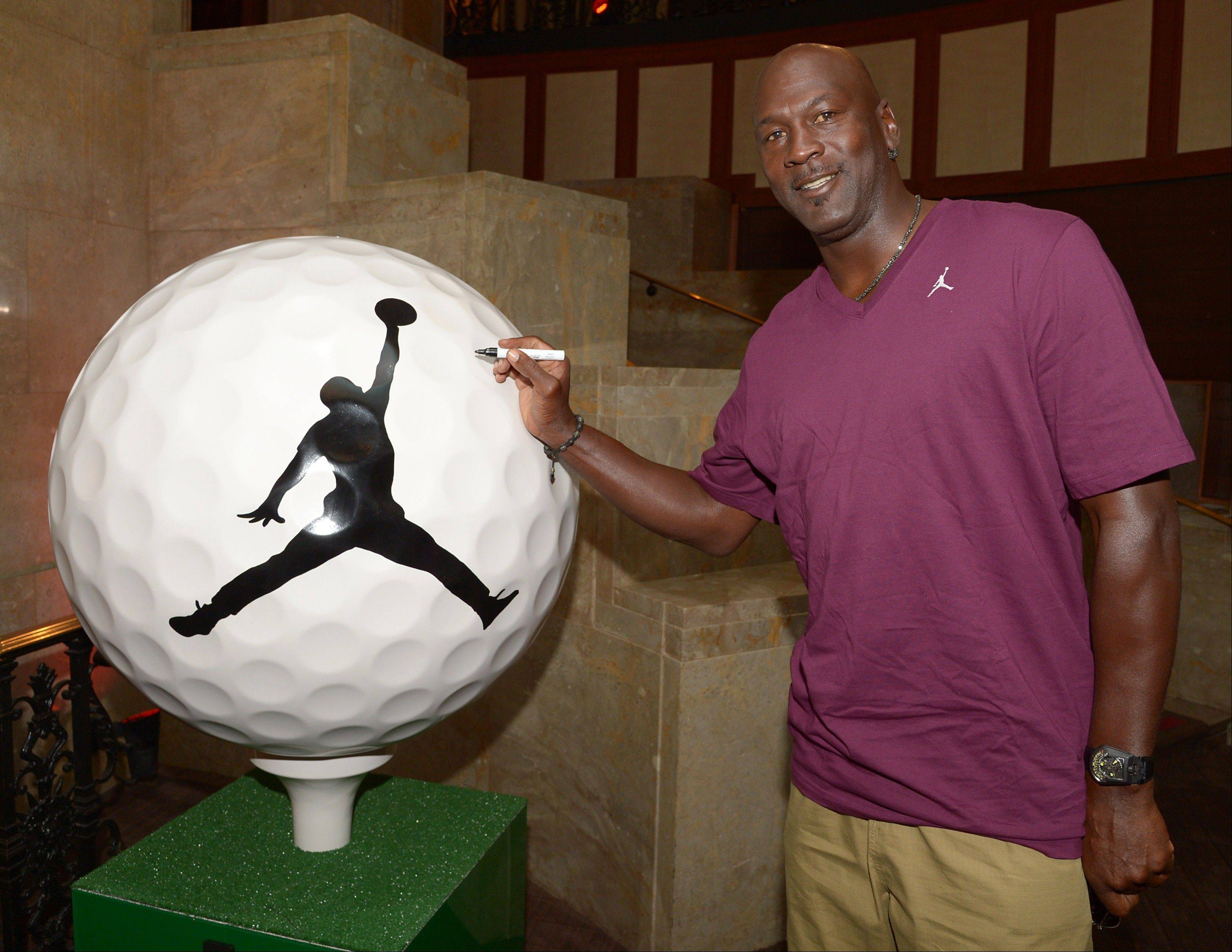 Michael Jordan signed his Ryder Cup Magnificant Moments golf ball at Michael Jordan's Steakhouse in Chicago this week. The ball will go on display with other celebrity-signed pieces that were decorated as part of a special fundraising campaign for local charities. The Ryder Cup balls will be showcases on the Magnificent Mile throughout September.
