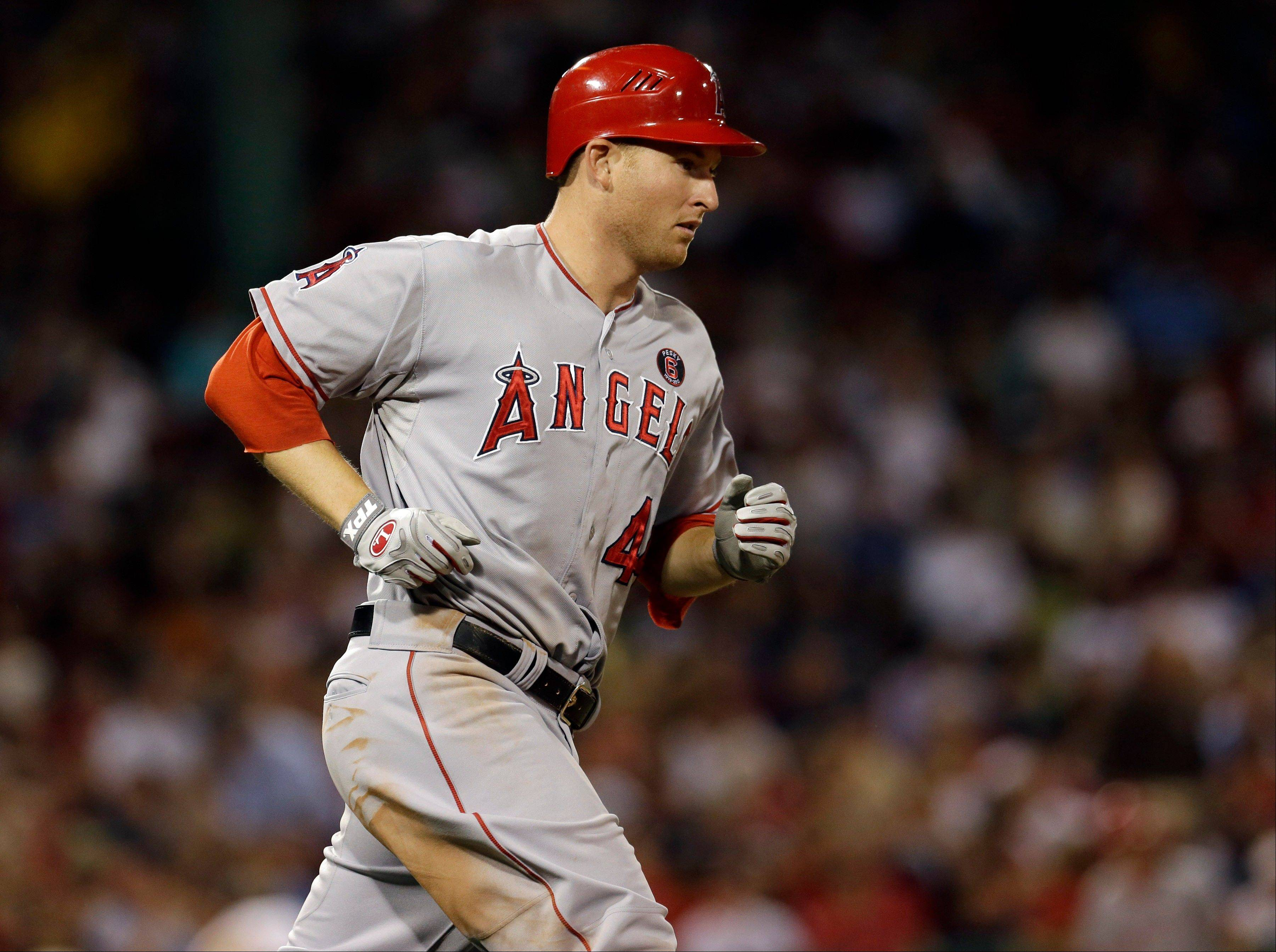 The Angels' Mark Trumbo runs to first after hitting a two-run home run against the Red Sox during the fifth inning Tuesday in Boston