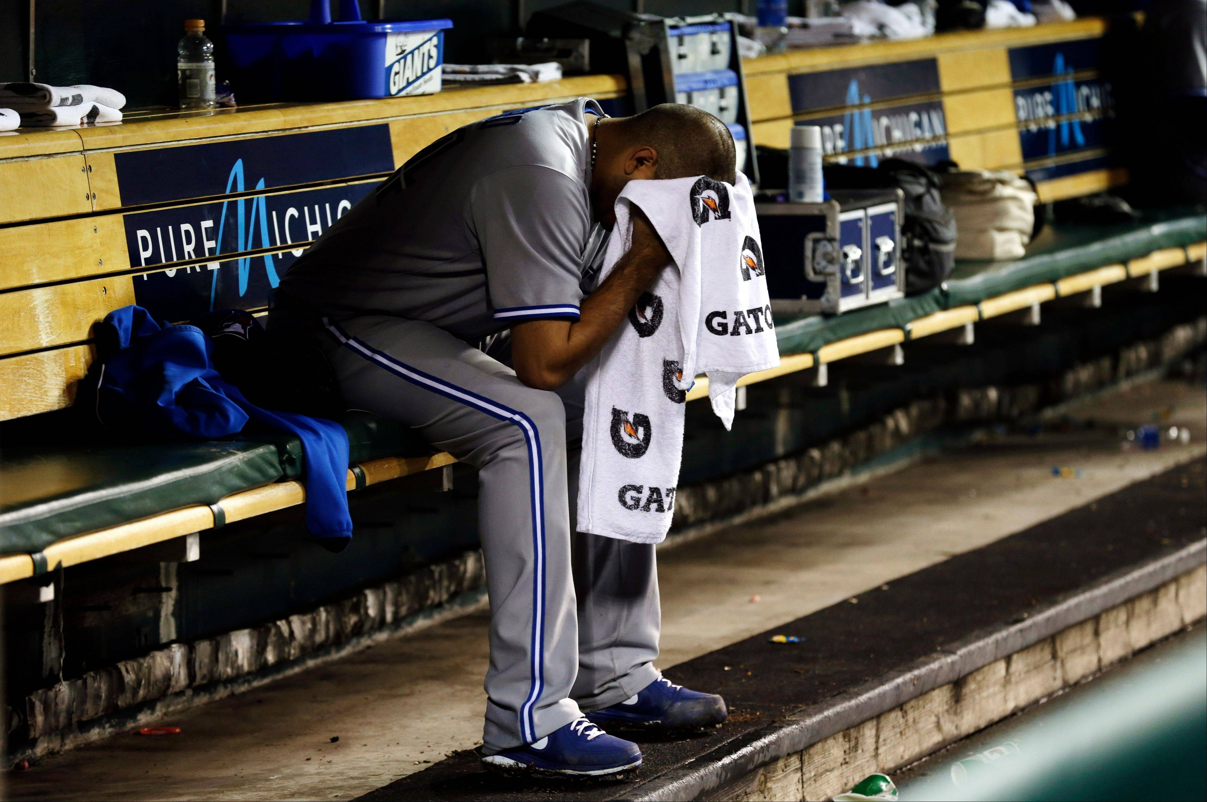 Blue Jays pitcher Ricky Romero sits on the bench after being taken out in the sixth inning Tuesday in Detroit.