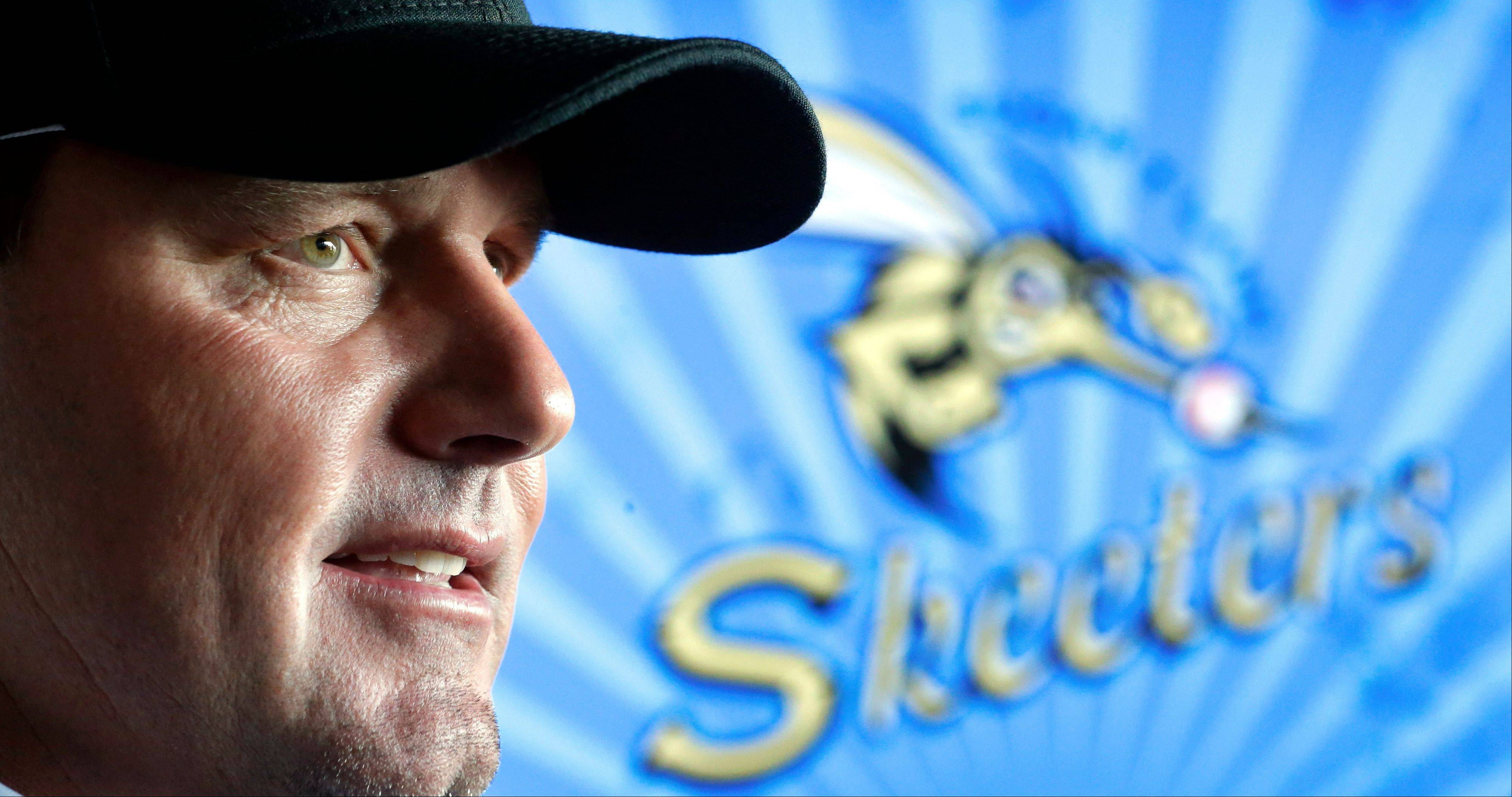 Roger Clemens talks with reporters Tuesday after a news conference officially announcing his signing with the Sugar Land Skeeters baseball team in Sugar Land, Texas.