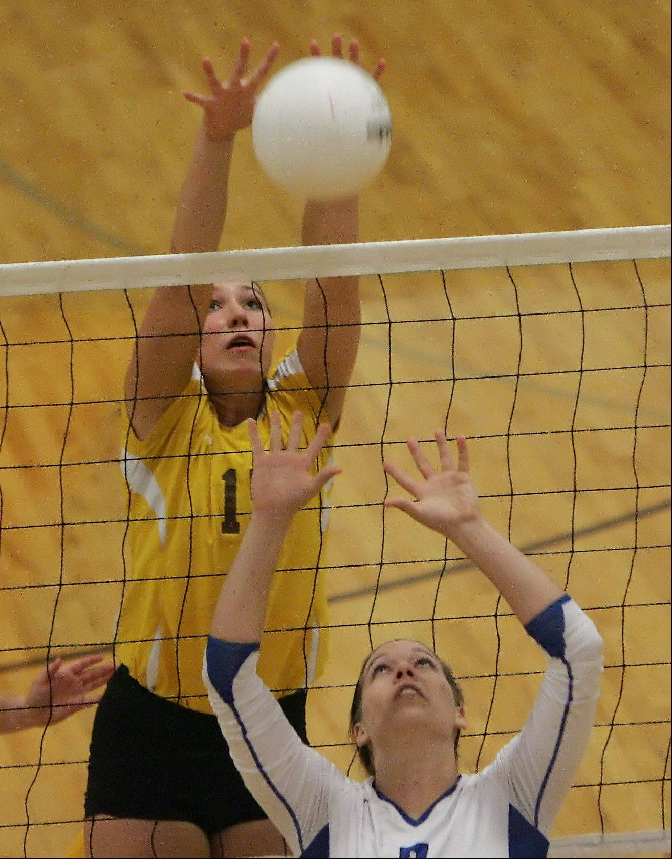 Carmel Catholic's Sierra Kepski blocks the shot by Lake Zurich setter Nicole Morrissey Tuesday in Mundelein.