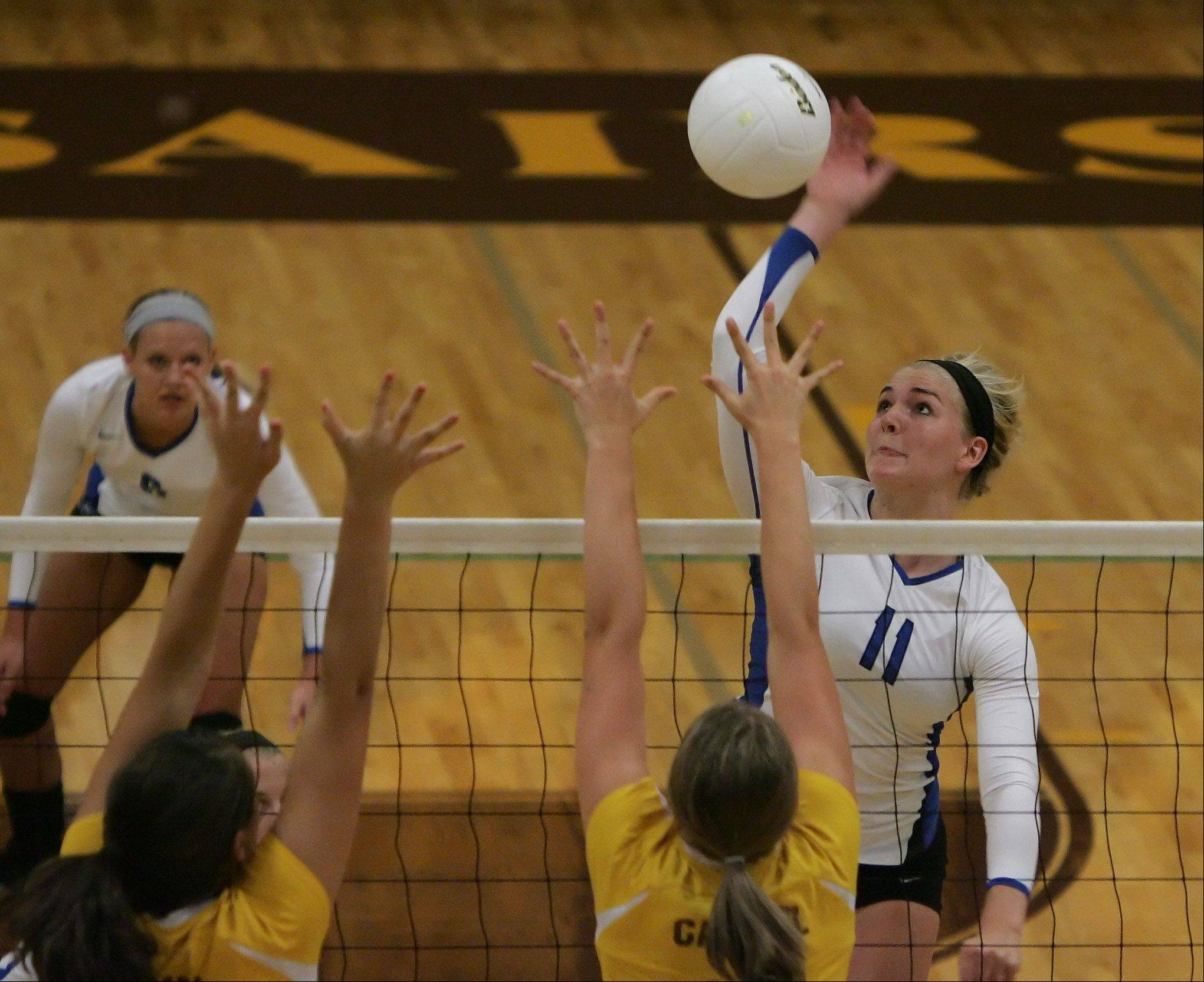 Lake Zurich's Layne Self slams the ball past Carmel Catholic defenders Tuesday in Mundelein.