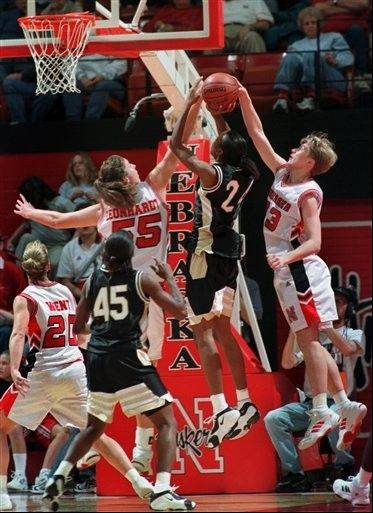 In a Jan. 18, 2000 photo, Nebraska's Casey Leonhardt (55) and Charlie Rogers (33) block a shot by Missour'si Amanda Lassiter (24). Rogers, who told police she was the victim of a vicious hate crime in July, 2012, was charged with making a false report Tuesday, Aug. 21, 2012 pleaded not guilty to the misdemeanor charge. Authorities issued an arrest warrant for Rogers Tuesday morning.
